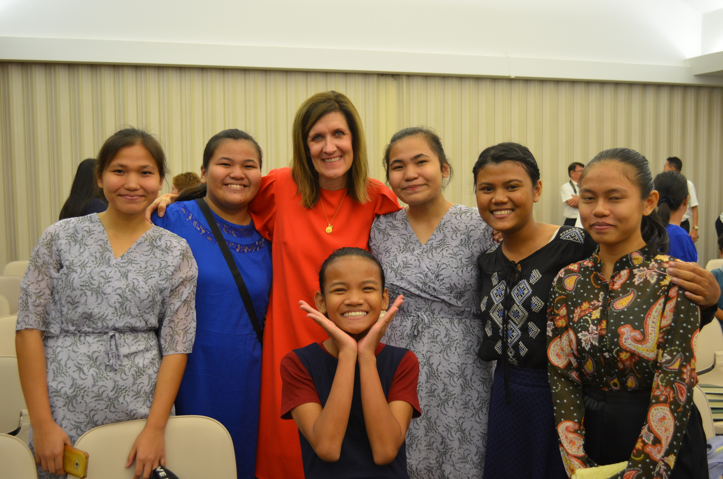 Sister Michelle D. Craig, first counselor in the Young Women general presidency, poses with a group of young women following a youth devotional in Miri, Malaysia, during a visit to the Asia Area of the Church from Aug. 17 to 24, 2019.