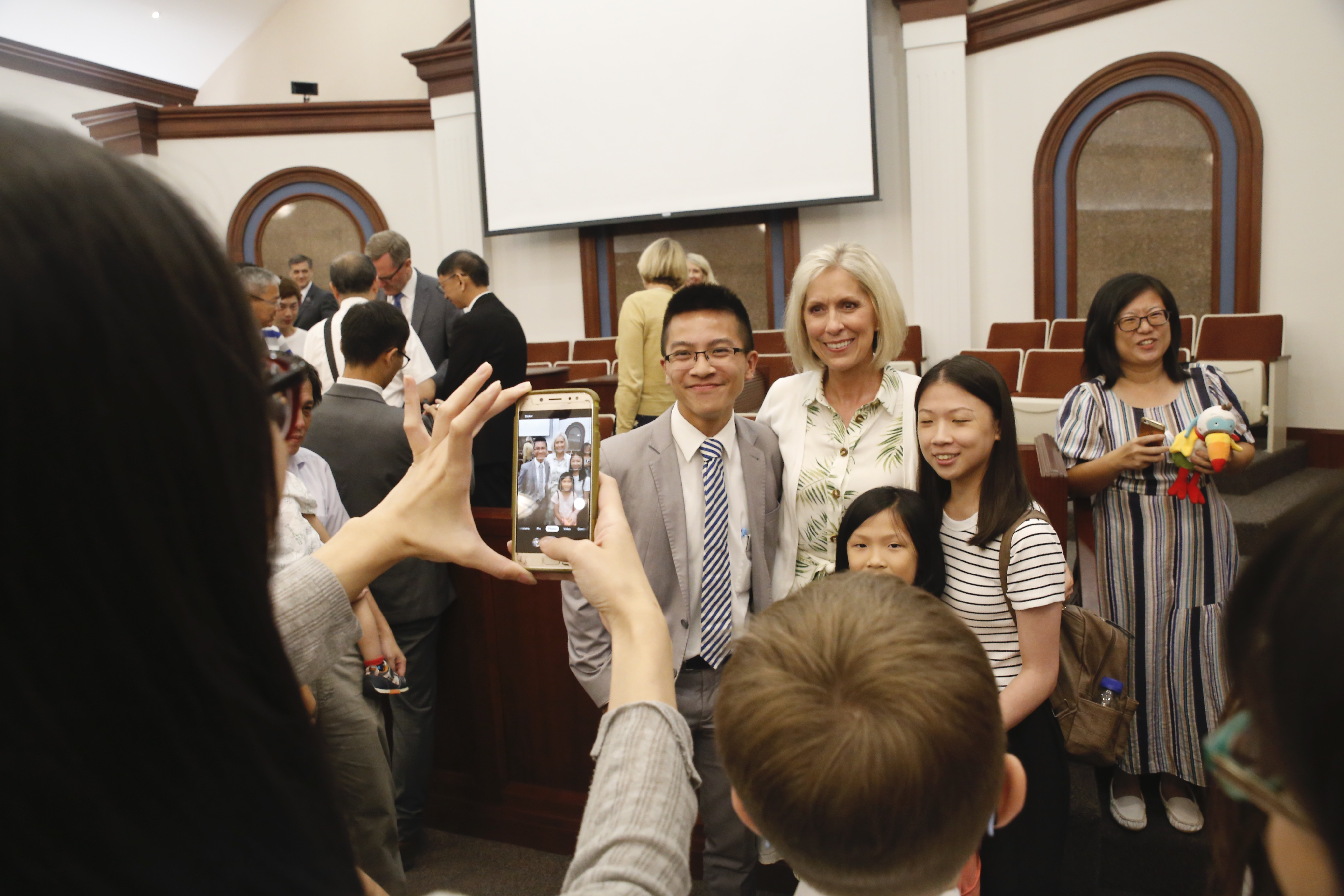 Sister Joy D. Jones, Primary general president, takes photos with members following a devotional in Taipei, Taiwan, during a visit to the Asia Area from Aug. 17 to 14, 2019.