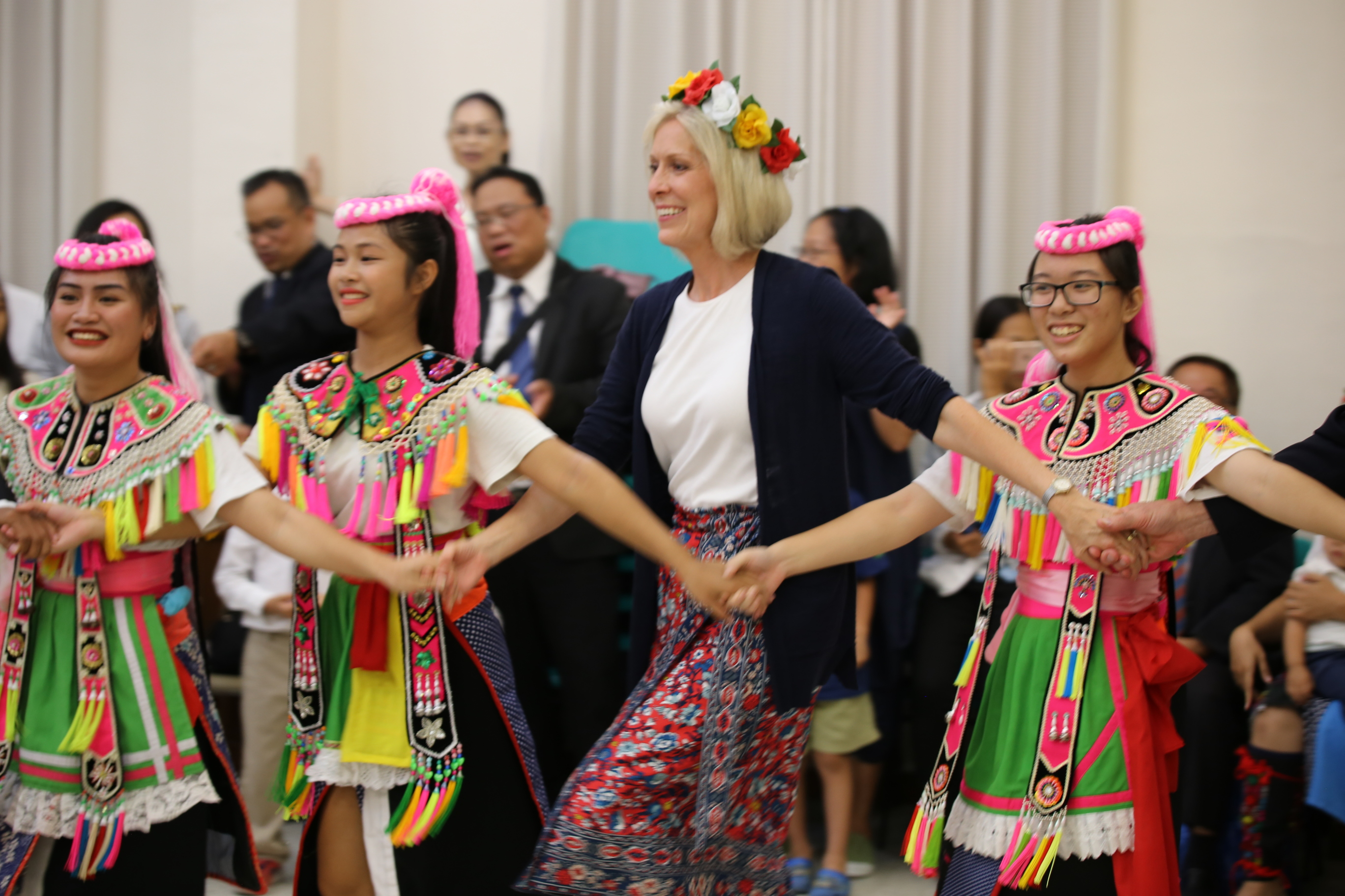 Sister Joy D. Jones, Primary general president, joins a dance with a group of youth during a devotional in Taitung, Taiwan, during a visit to the Asia Area from Aug. 17 to 24, 2019.