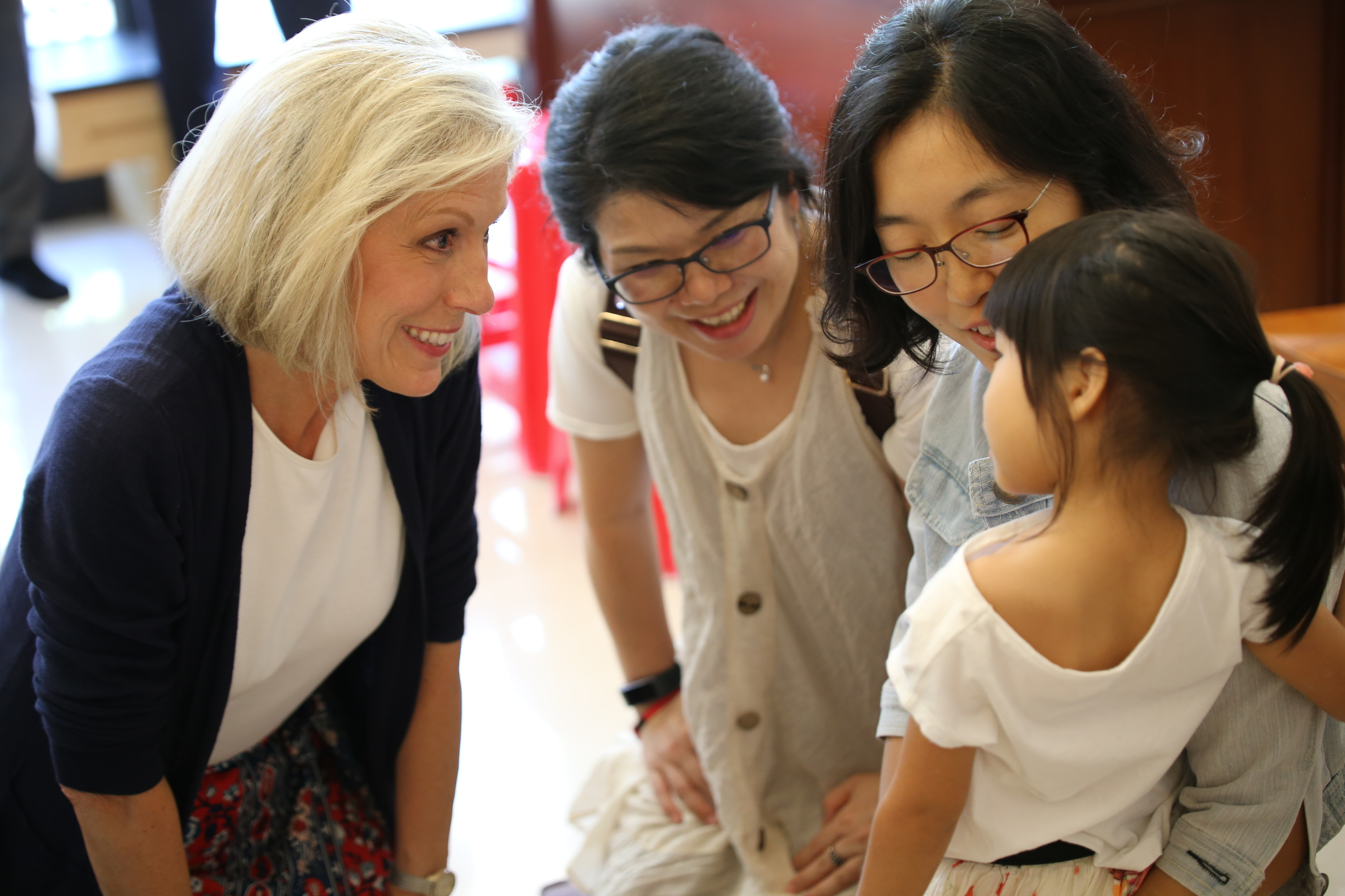Sister Joy D. Jones, Primary general president, interacts with youth during a visit to a member family's home in Taitung, Taiwan, during a visit to the Asia Area from Aug. 17 to 14, 2019.