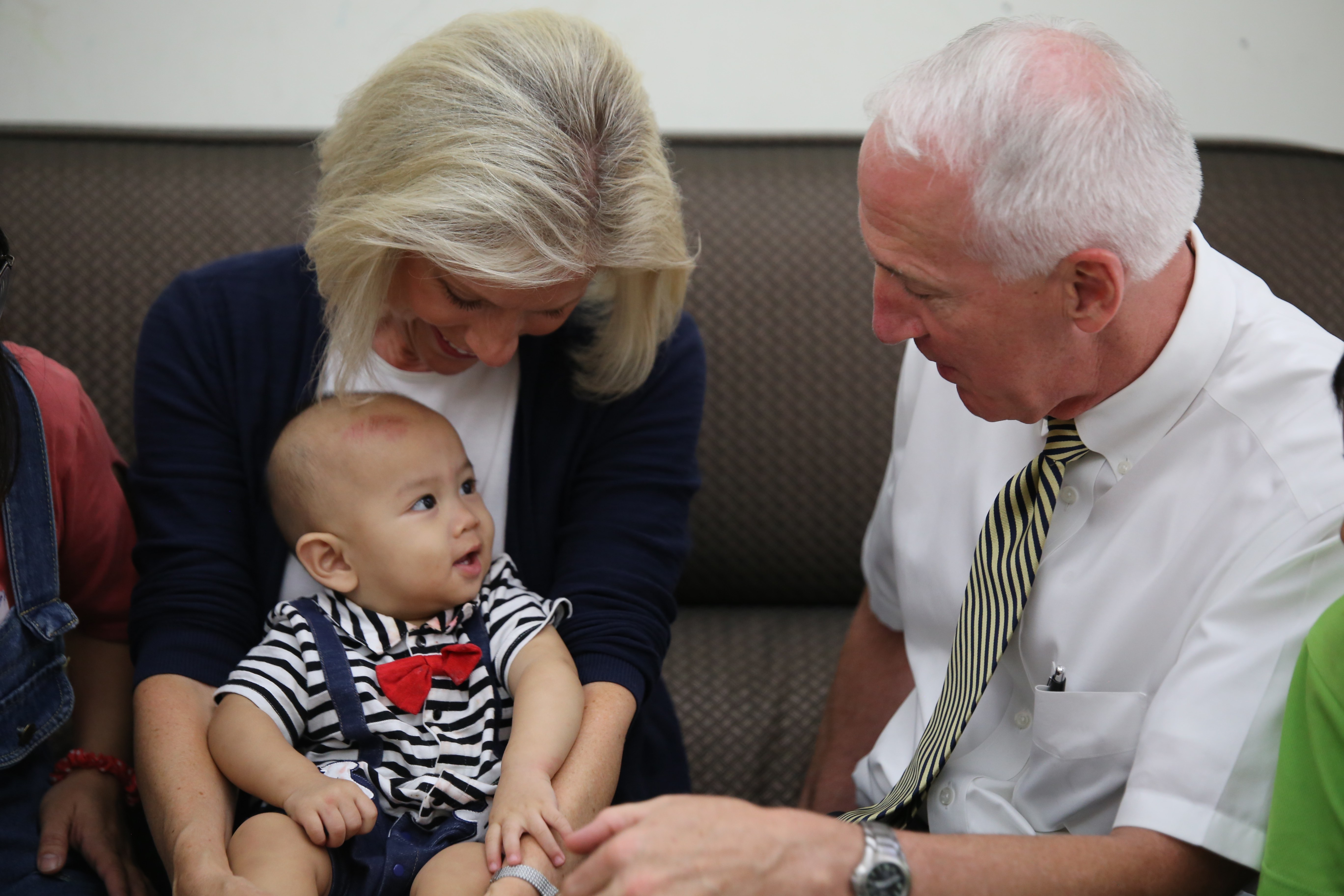 Sister Joy D. Jones, Primary general president, and her husband, Brother Robert B. Jones, interact with a baby while visiting a family in their home in Taitung, Taiwan, during a visit to the Asia Area from Aug. 17 to 14, 2019.