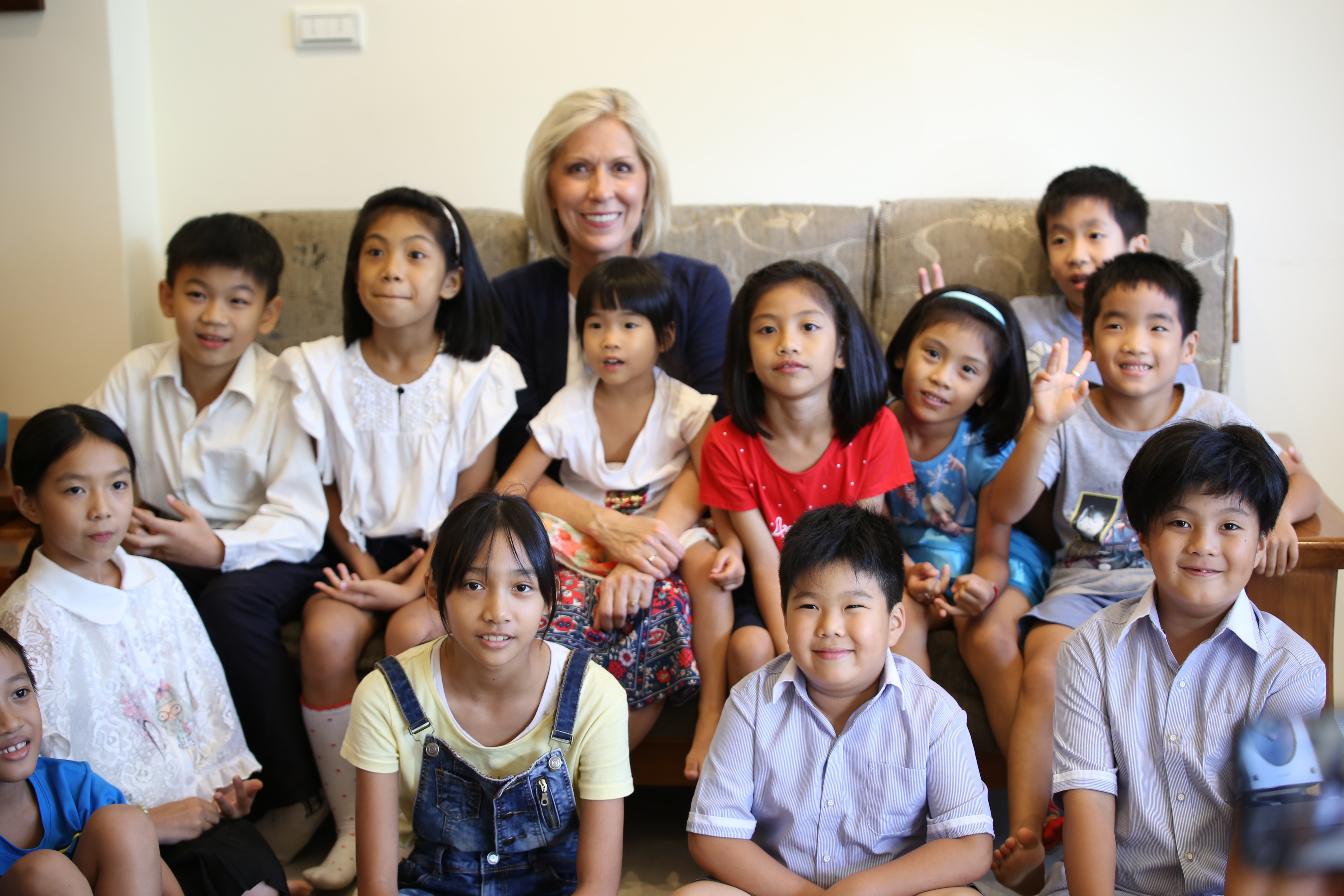 Sister Joy D. Jones, Primary general president, takes a photo with youth while visiting the home of members in Taiwan during a visit to the Asia Area from Aug. 17 to 14, 2019.
