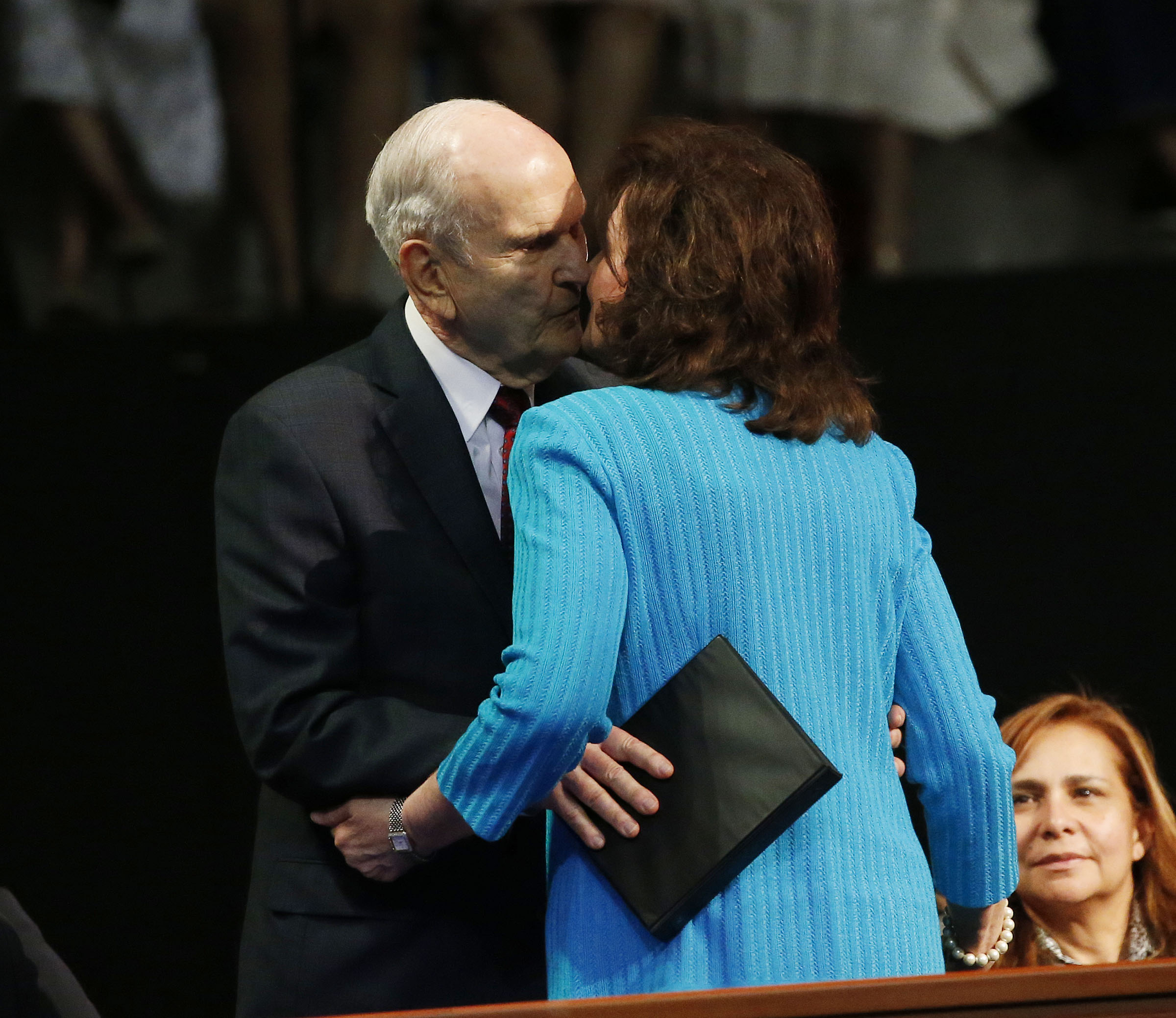 President Russell M. Nelson of The Church of Jesus Christ of Latter-day Saints kisses his wife, Sister Wendy Nelson, after she speaks in a Latin America Ministry Tour devotional in Quito, Ecuador, on Monday, Aug. 26, 2019.