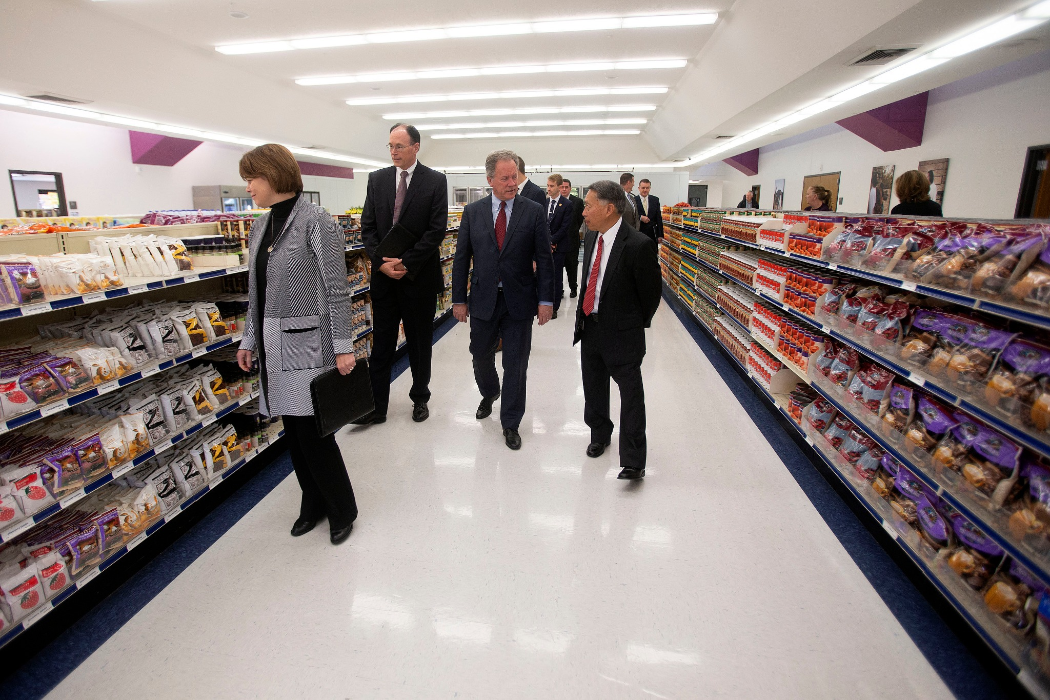 David Beasley, executive director of the United Nations World Food Program, visits the BIshops' Central Storehouse on Monday, Sept. 30, 2019, with Sister Sharon Eubank, president of Latter-day Charities and counselor in the Relief Society general presidency, and Bishop W. Christopher Waddell of the Presiding Bishopric.