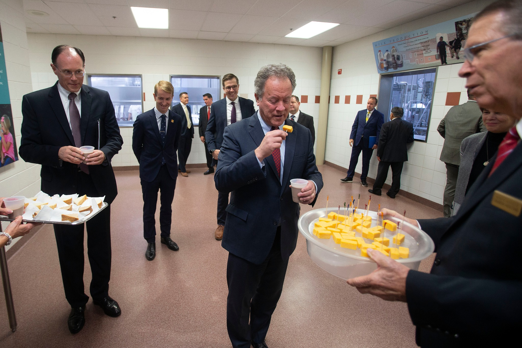 David Beasley, executive director of the United Nations World Food Program, and samples some of the products Welfare Square produces — including cheese, chocolate milk, break and jam — during a tour with Bishop W. Christopher Waddell of the Presiding Bishopric on Monday, Sept. 30, 2019.