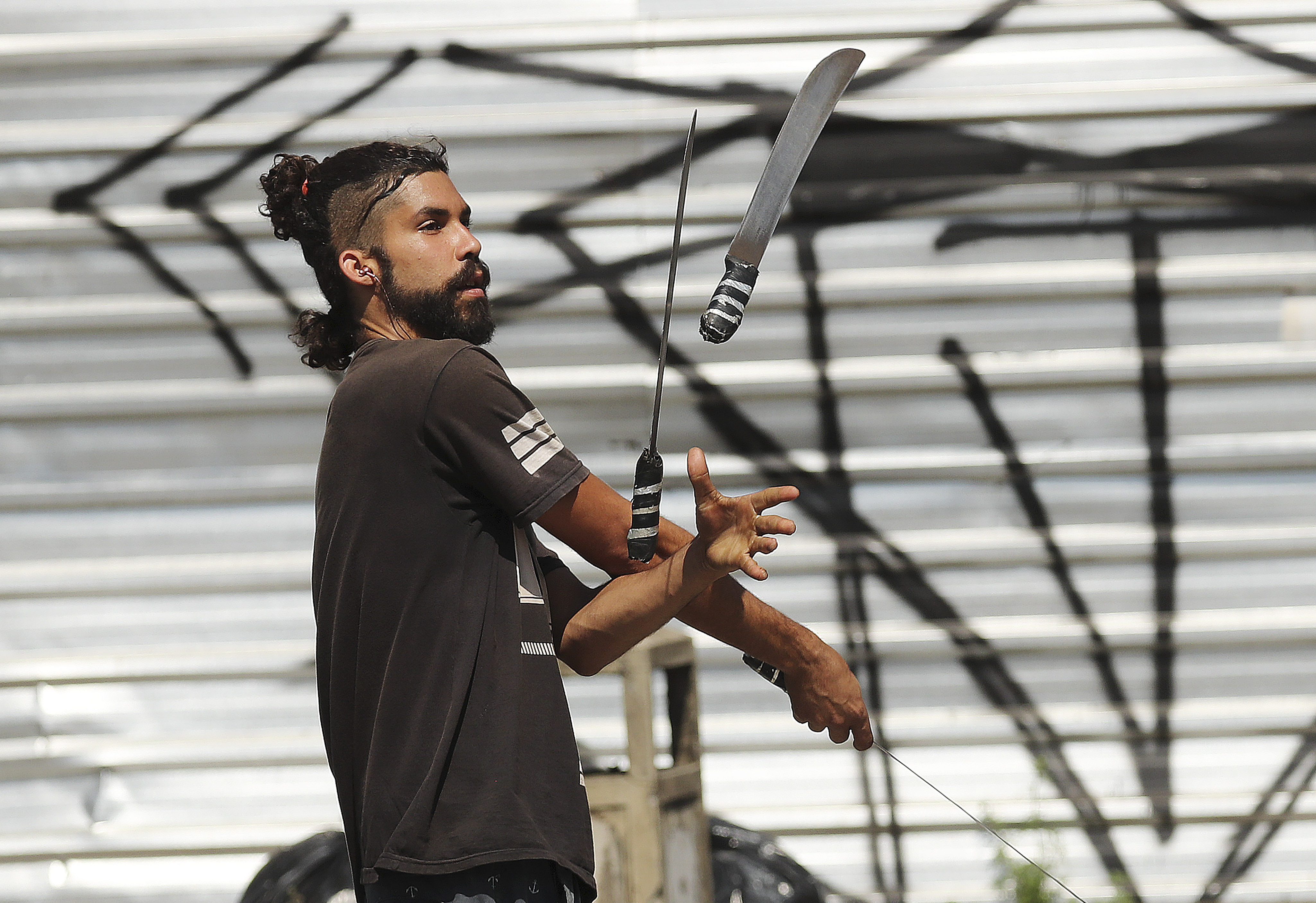 A juggler juggles for money on the street in Sao Paulo, Brazil, on Aug. 31, 2019.