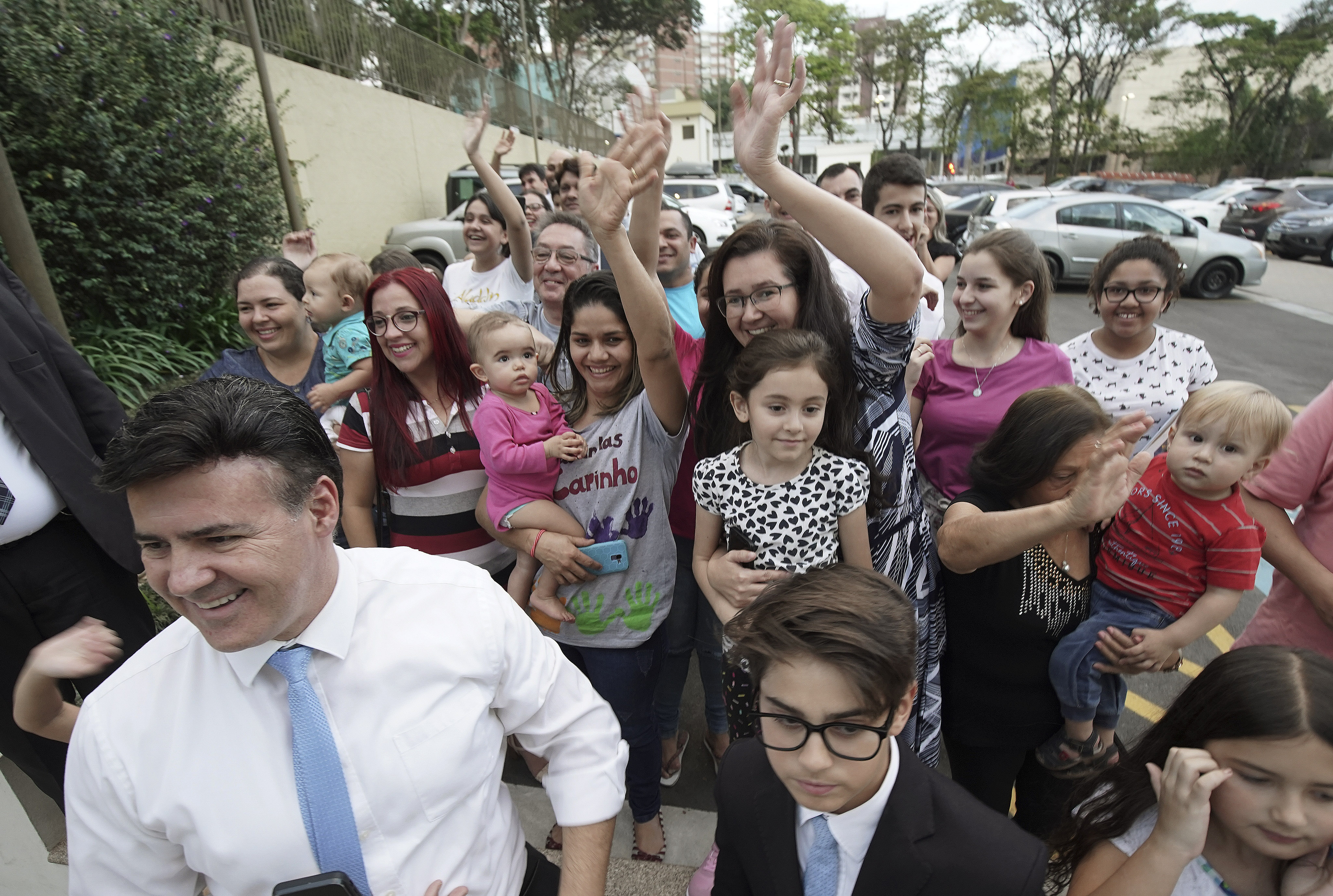 Those outside the Sao Paulo Temple Visitors' Center wave to President Russell M. Nelson of The Church of Jesus Christ of Latter-day Saints in Sao Paulo, Brazil, on Aug. 31, 2019.