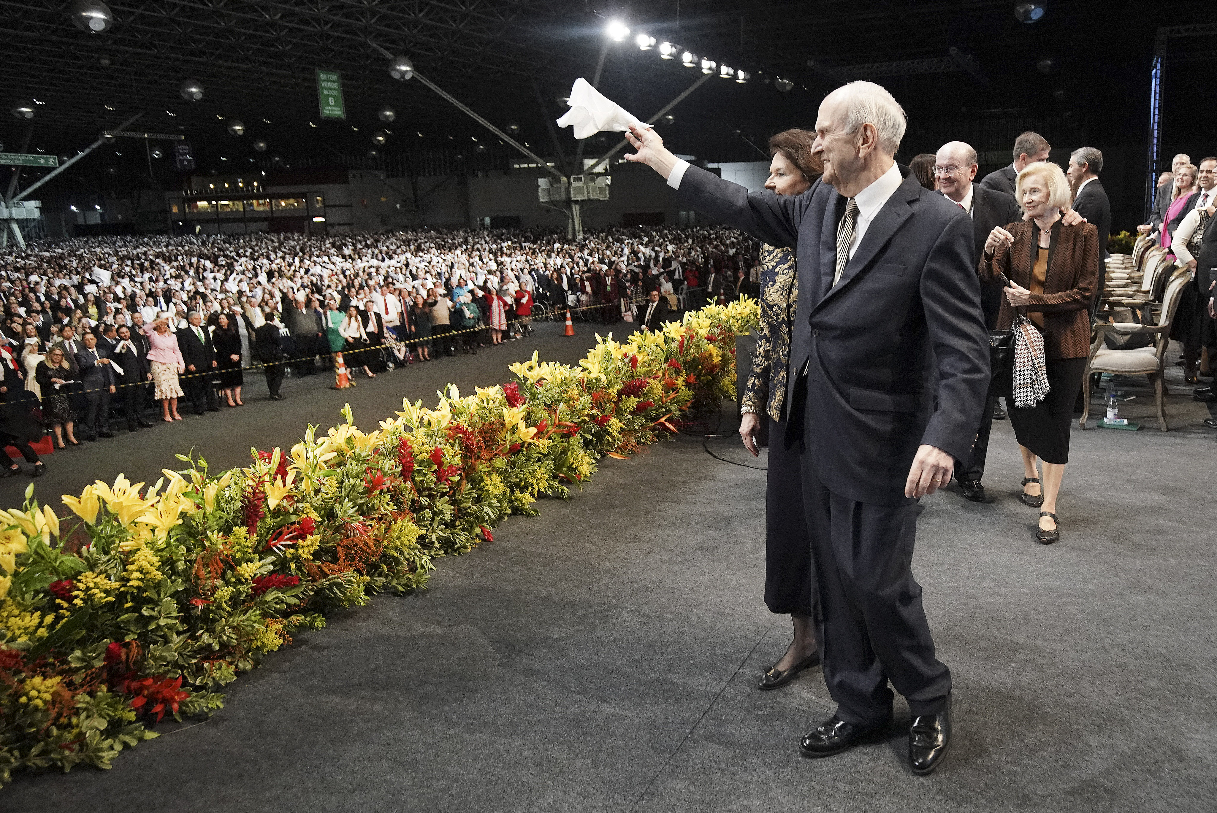 President Russell M. Nelson of The Church of Jesus Christ of Latter-day Saints and his wife, Sister Wendy Nelson, and Elder Quentin L. Cook of the Quorum of the Twelve Apostles and his wife, Sister Mary Cook, wave to attendees after a devotional in Sao Paulo, Brazil, on Sunday, Sept. 1, 2019.