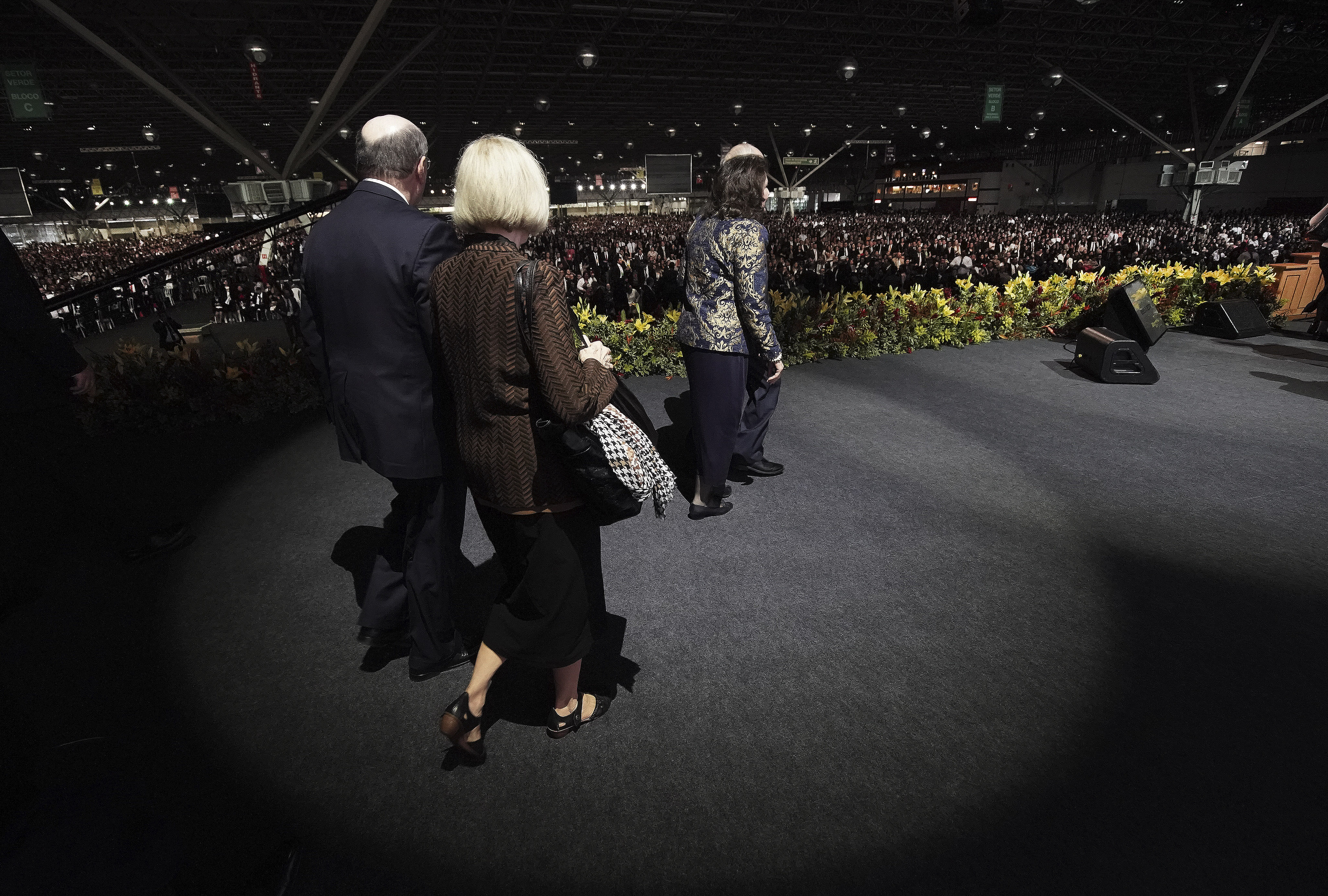 President Russell M. Nelson of The Church of Jesus Christ of Latter-day Saints and his wife, Sister Wendy Nelson, and Elder Quentin L. Cook of the Quorum of the Twelve Apostles and his wife, Sister Mary Cook, walk onto the stage for a devotional in Sao Paulo, Brazil, on Sunday, Sept. 1, 2019.