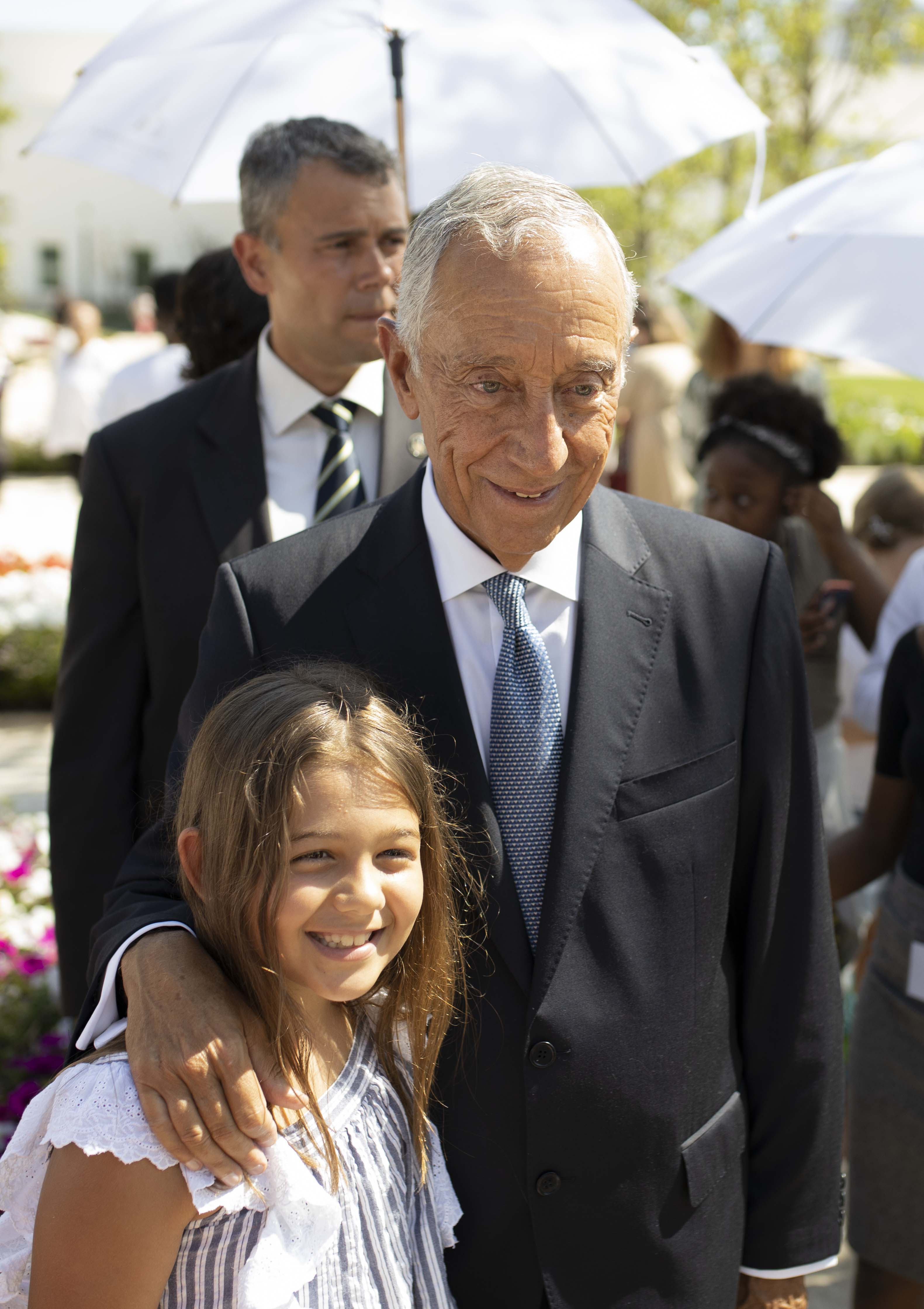 The president of Portugal, Marcelo Rebelo de Sousa takes a picture with a child on the Lisbon Portugal Temple grounds on Aug. 29, 2019.