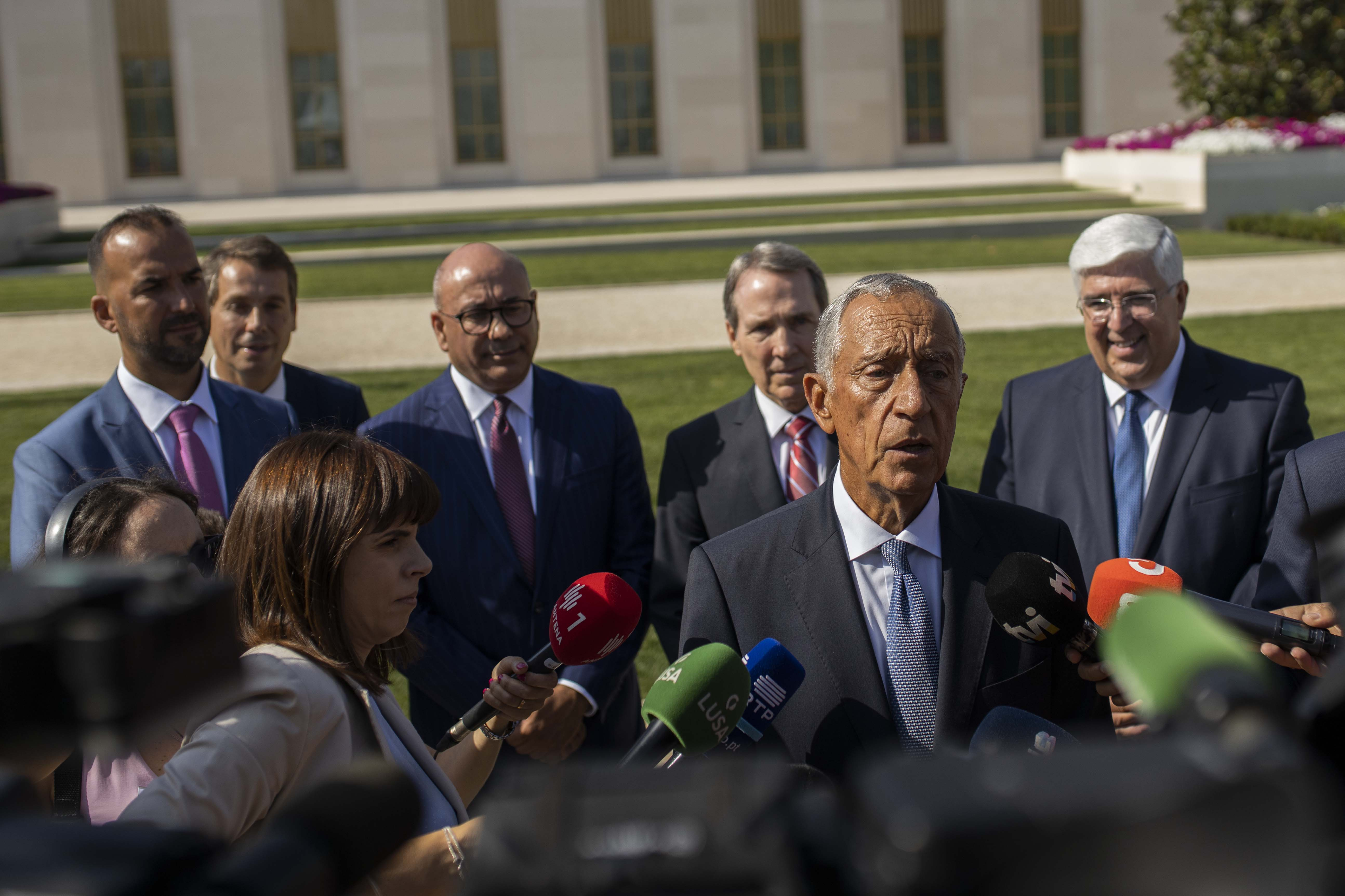 Marcelo Rebelo de Sousa, p[resident of Portugal, and Church leaders address the media gathered in front of the Lisbon Portugal Temple on Aug. 29, 2019.