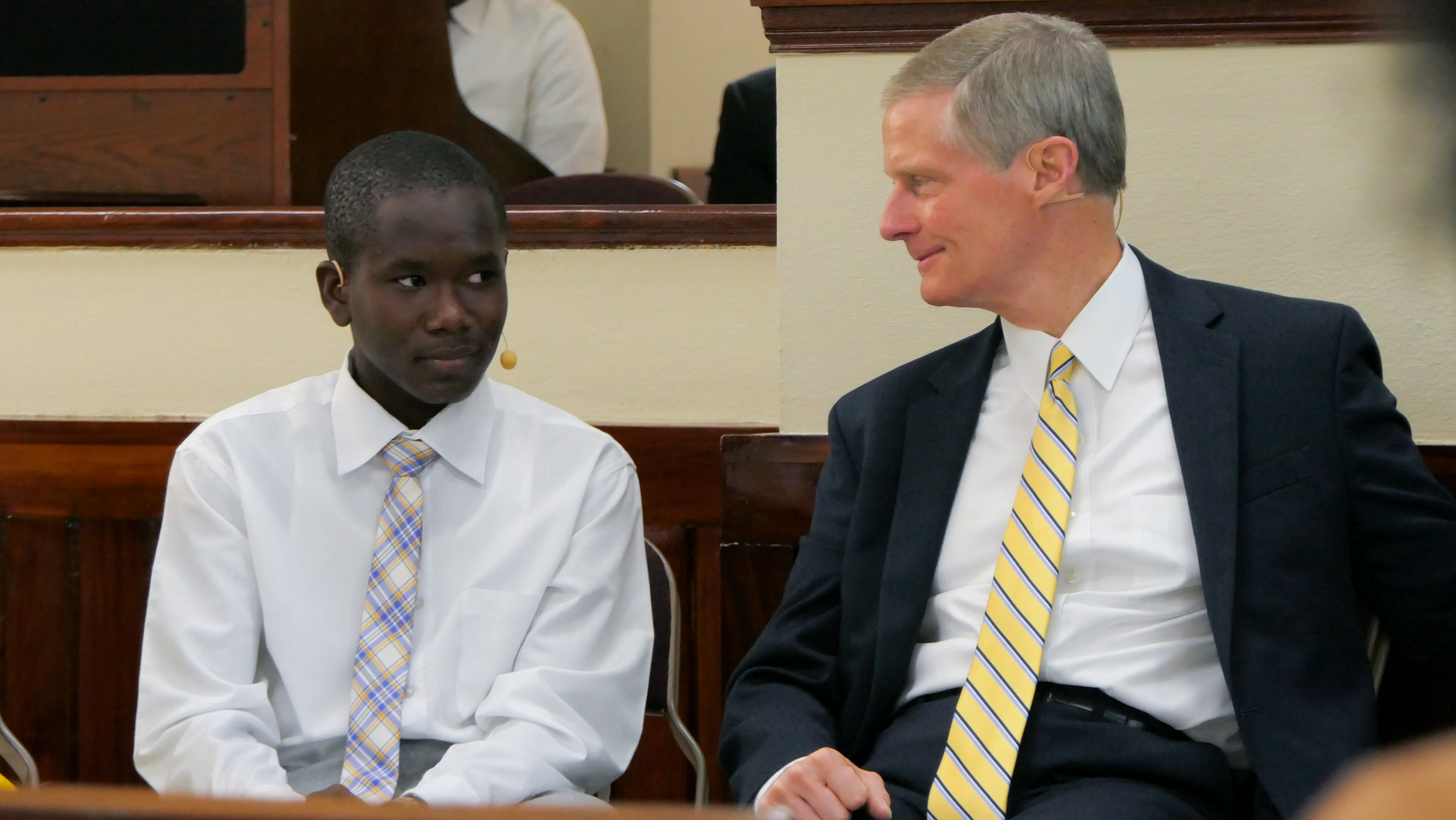 Elder David A. Bednar enjoys a chat with a young man during Aug. 31, 2019, youth devotional in Port-au-Prince, Haiti.