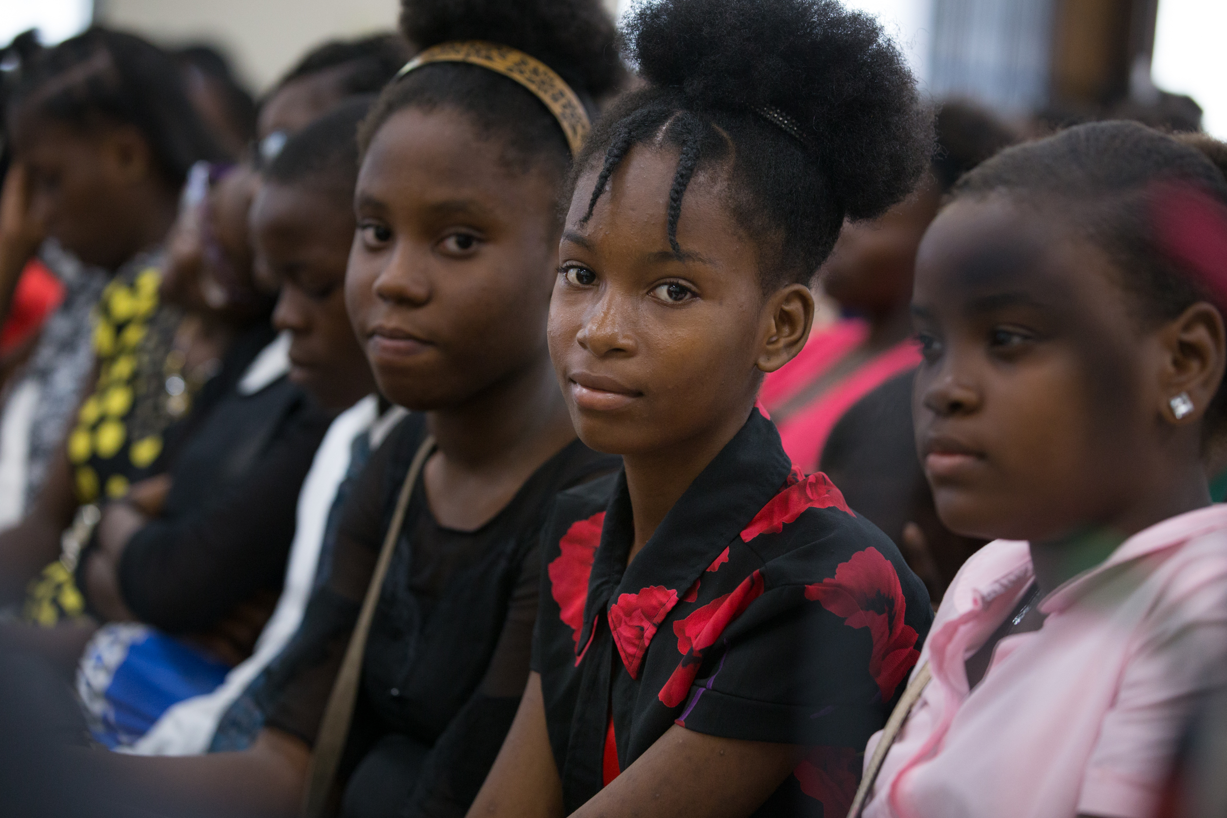 Young women await the arrival of Elder David A. Bednar and other Church leaders for a youth devotional in Port-au-Prince, Haiti, on Aug. 31, 2019