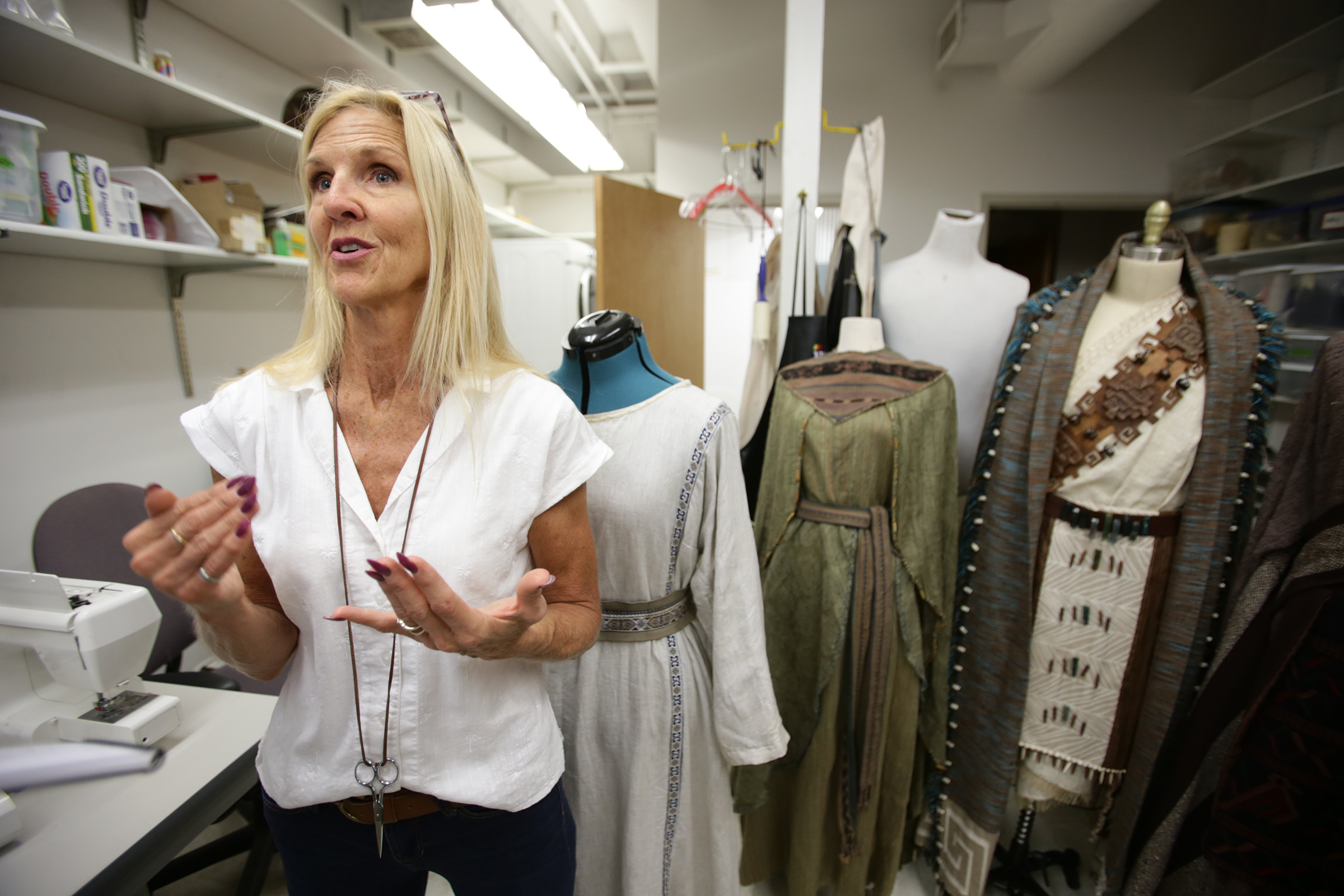 Iffer Mitchell, assistant costume department head, talks about the costumes and other items used in the Book of Mormon videos in Provo, Utah, at the Motion Picture Studio on Tuesday, Sept. 3, 2019.