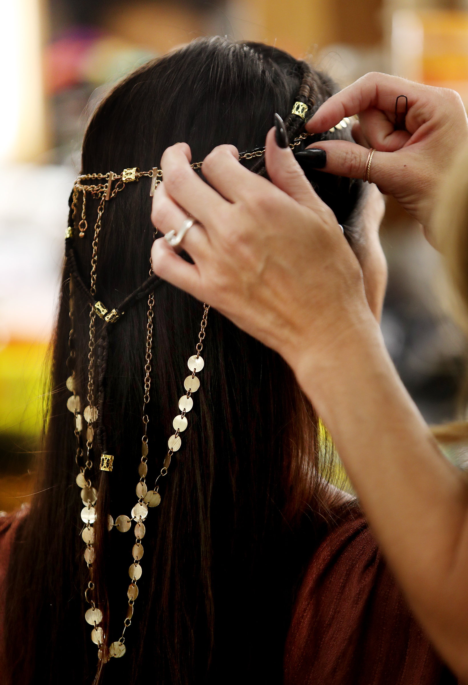 Erin Forsloff gets adornment done on her hair as work on production of the Book of Mormon videos series continues in Provo, Utah, at the Motion Picture Studio on Tuesday, Sept. 3, 2019.