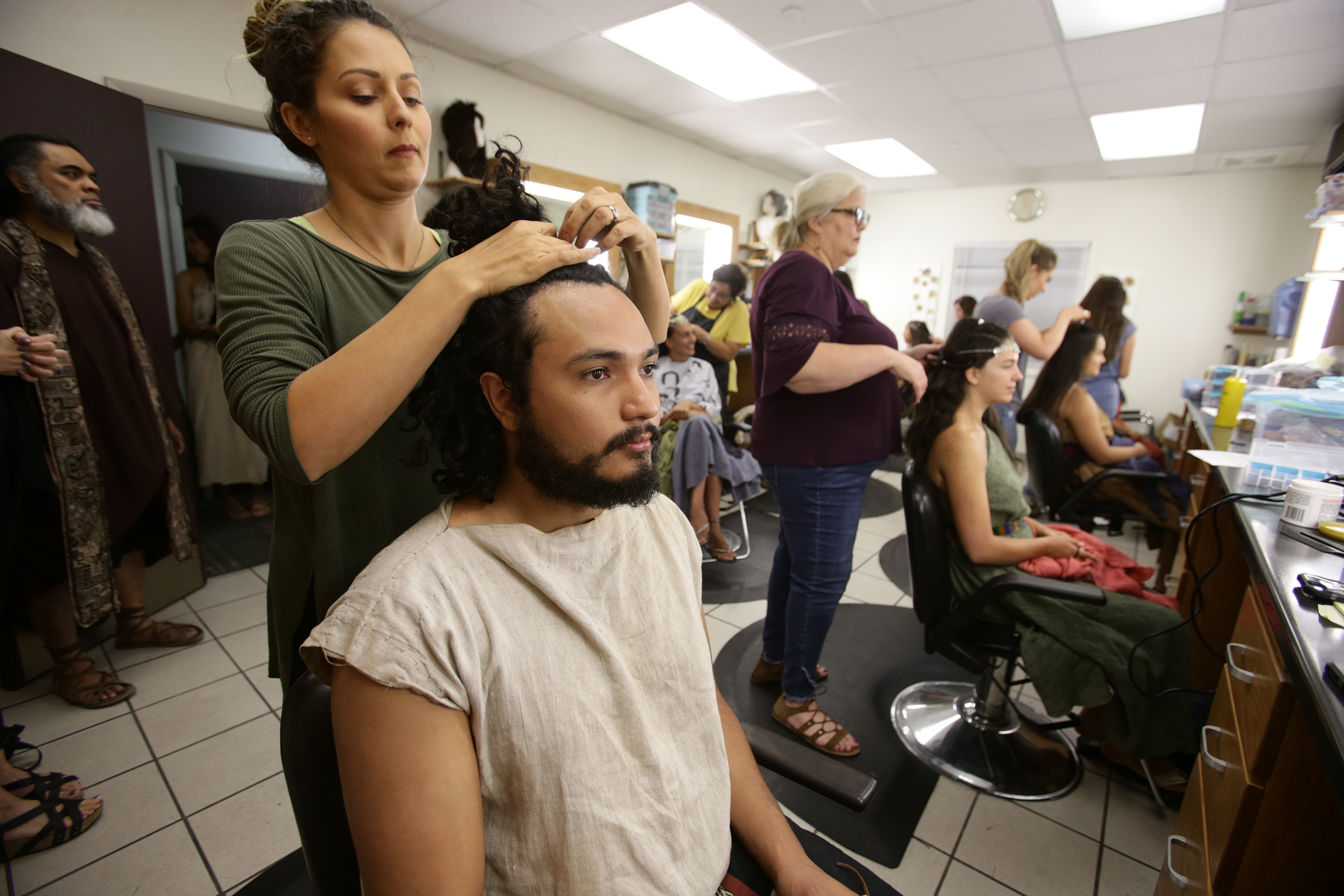 Tiffany Dickens, Key Hair, works with Daryn Vallejo, who plays King Noah's guard as work on production of the Book of Mormon video series continues in Provo, Utah, at the Motion Picture Studio on Tuesday, Sept. 3, 2019.