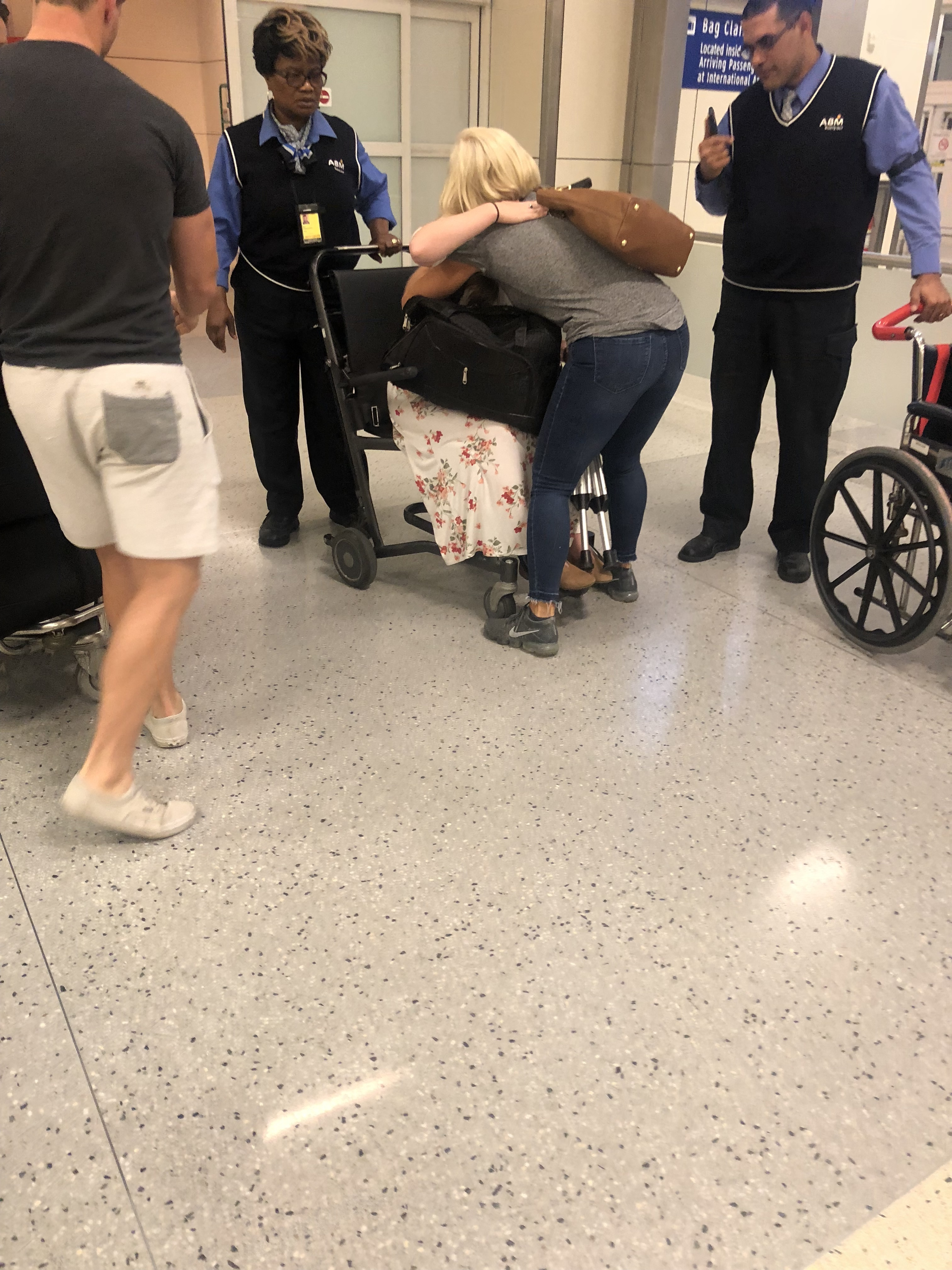 Monique McDown arrives at the airport in a wheelchair following an accident on her mission in Curitiba, Brazil, which left her paralyzed.