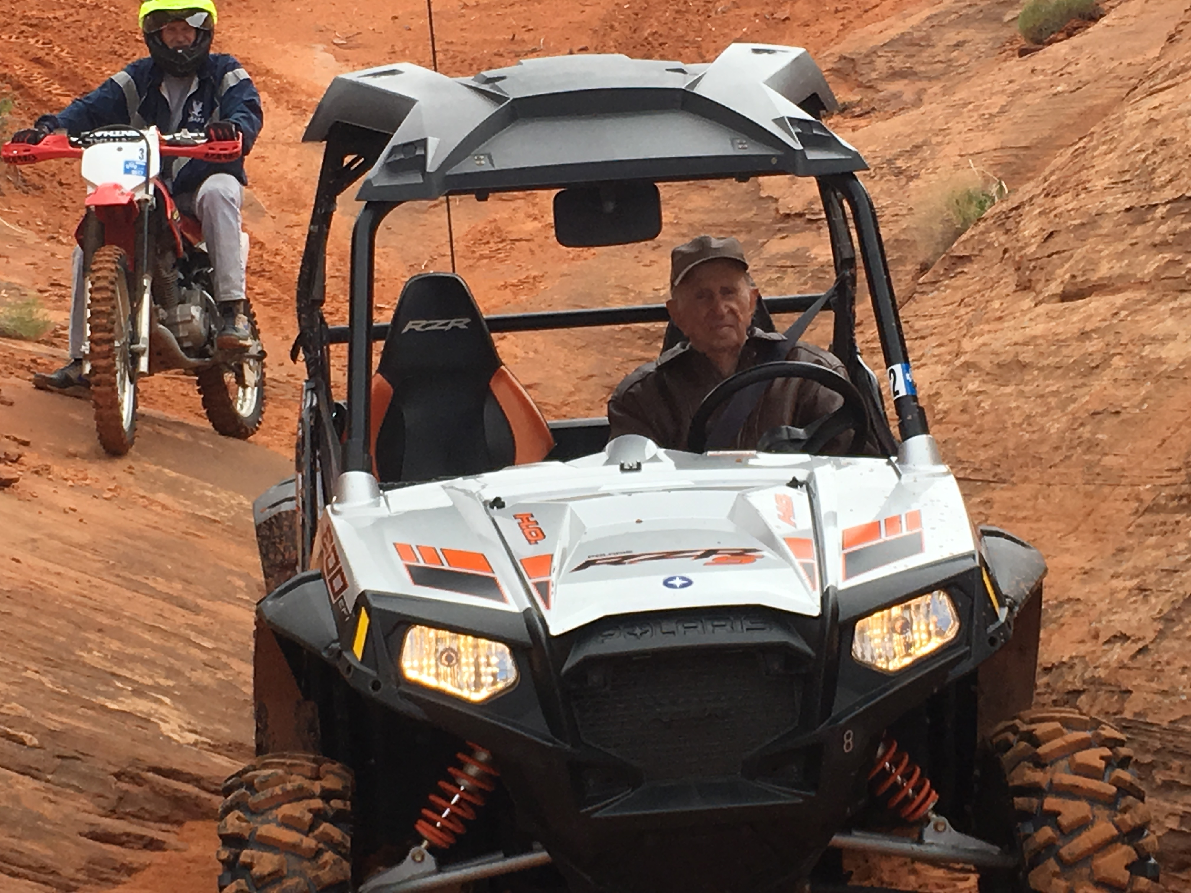 Centenarian Carl Freeman takes the wheel of an off-road vehicle during a 2018 excursion to Utah's sand dunes.