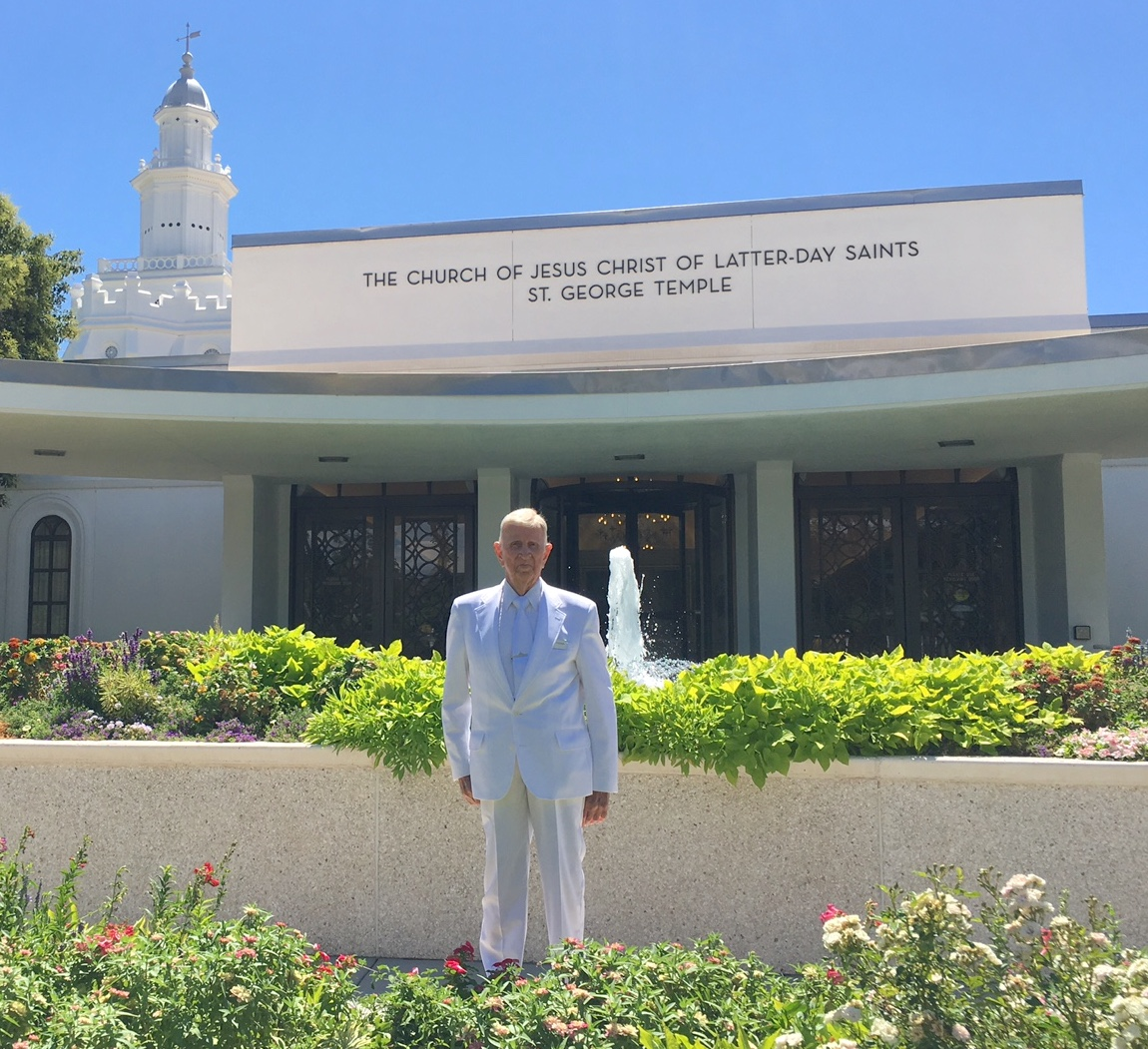 Carl Freeman, 104, stands outside the St. George Utah Temple where he work in the baptistry and at the recommend desk.