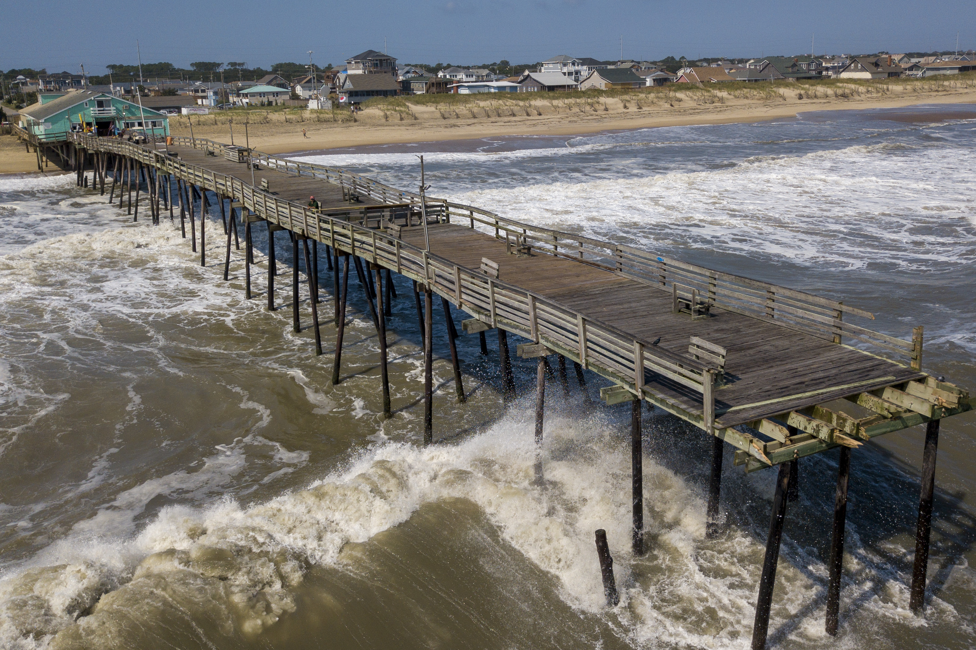 Waves continue to pound the Avalon pier after a large portion of the pier was washed away by Hurricane Dorian which moved through the area Friday in Kill Devil Hills, NC., Saturday, Sept. 7, 2019. (AP Photo/Steve Helber)