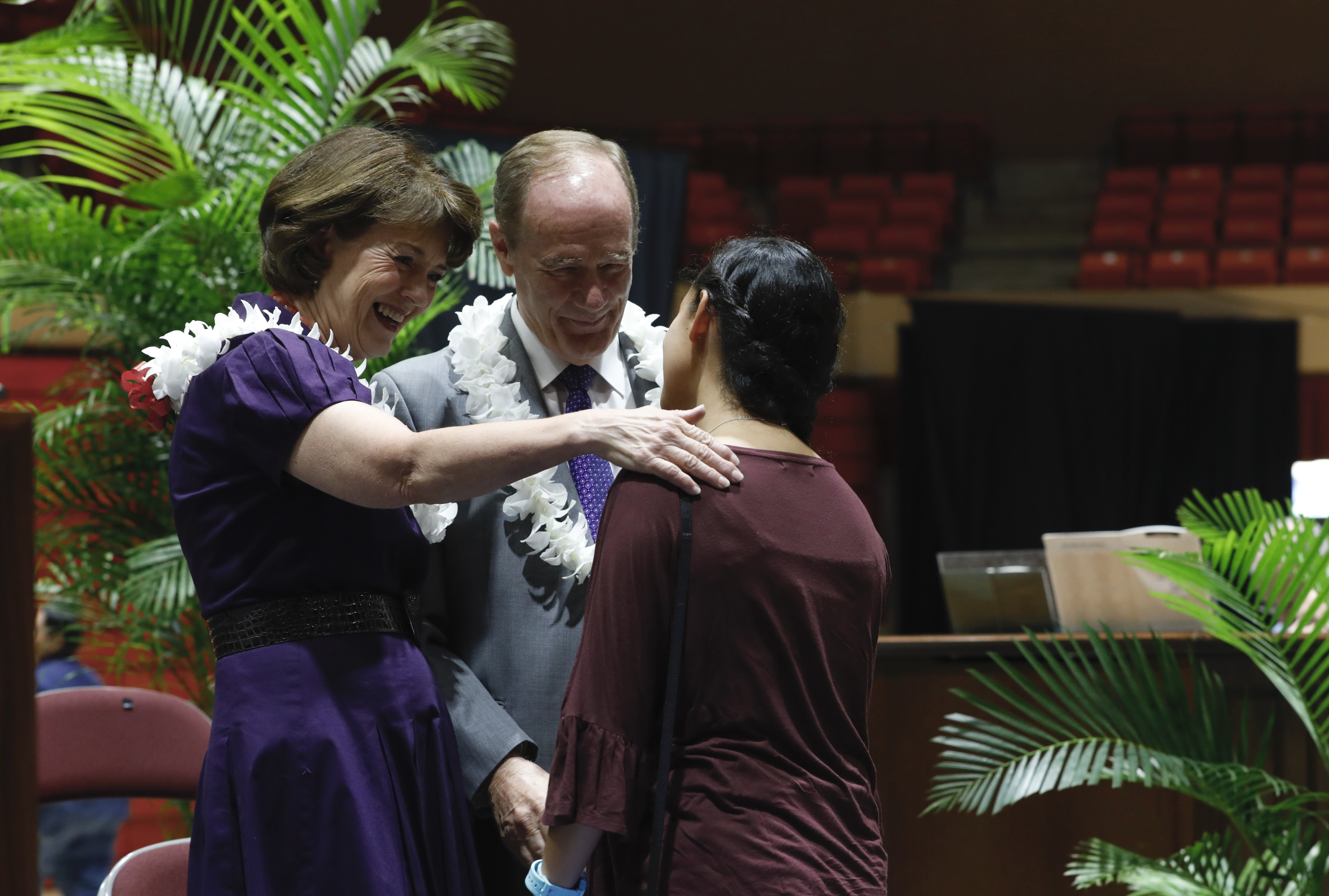 President John S. Tanner and his wife, Sister Susan W. Tanner, talk to a student at the BYU - Hawaii Devotional on September 10, 2019.