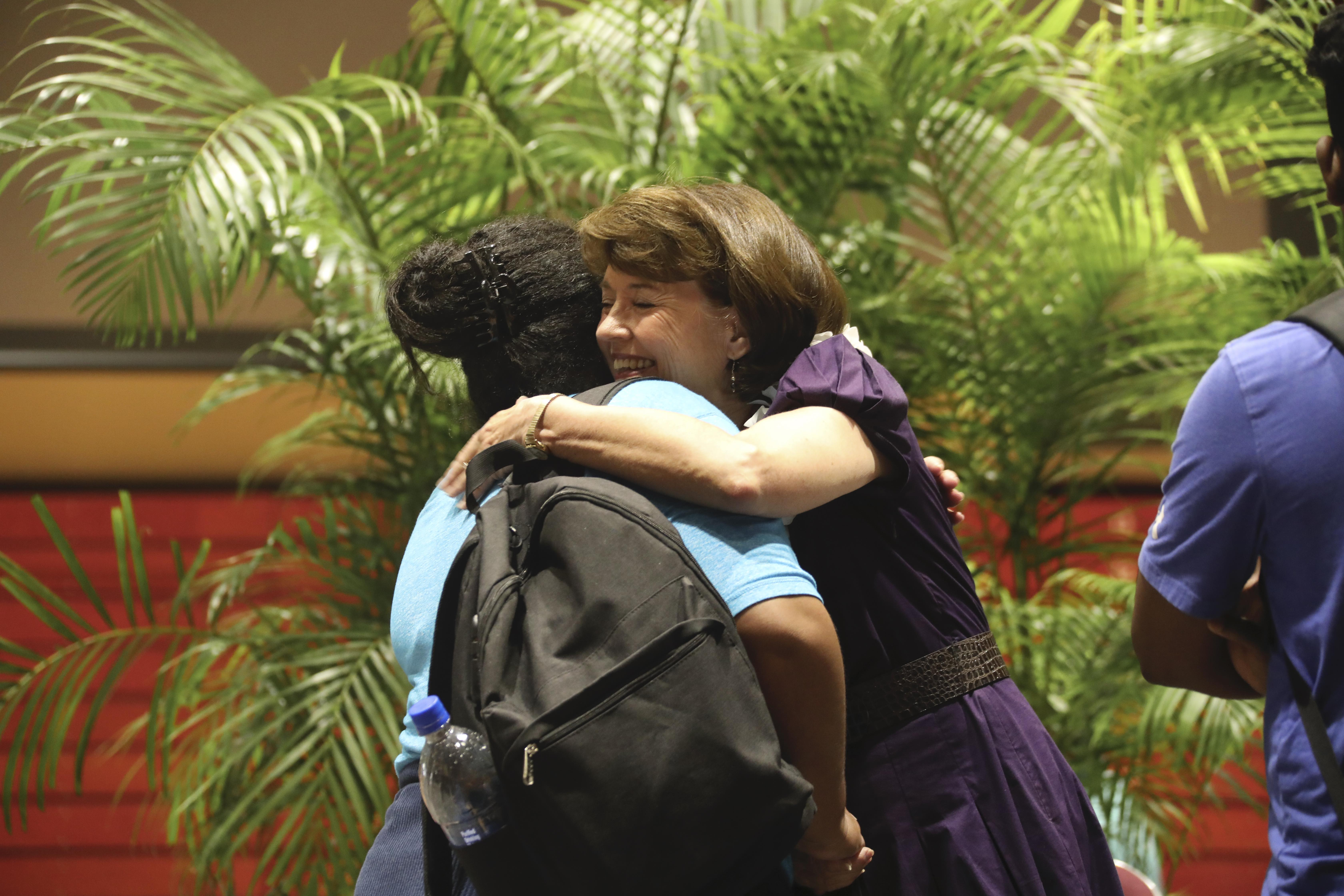 Sister Susan W. Tanner hugs a student at the BYU - Hawaii Devotional on September 10, 2019.