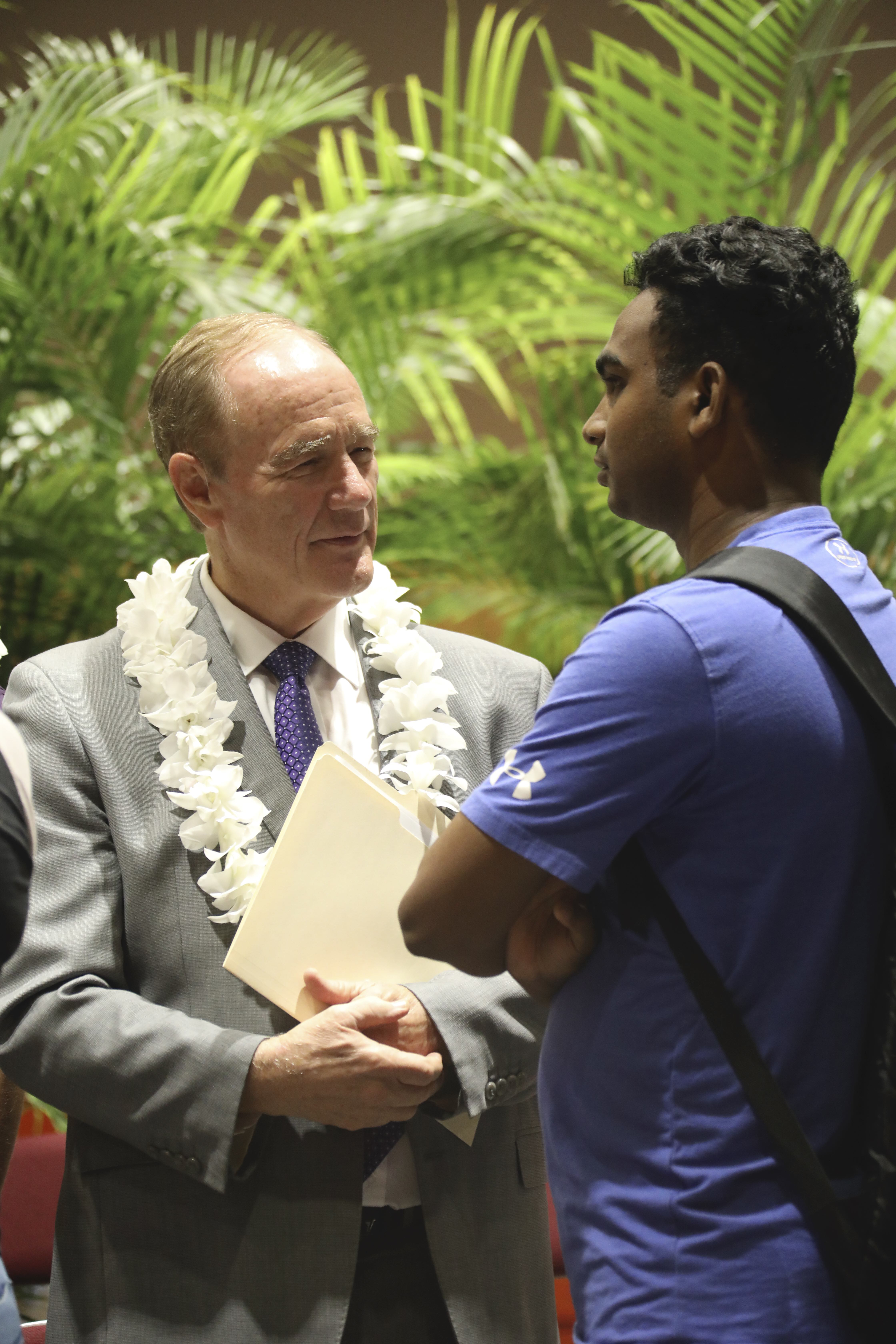 President John S. Tanner talks to a student at the BYU - Hawaii Devotional on September 10, 2019.