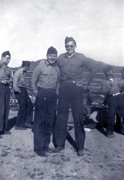 L. Tom Perry, right, poses for a photo with a fellow Marine.
