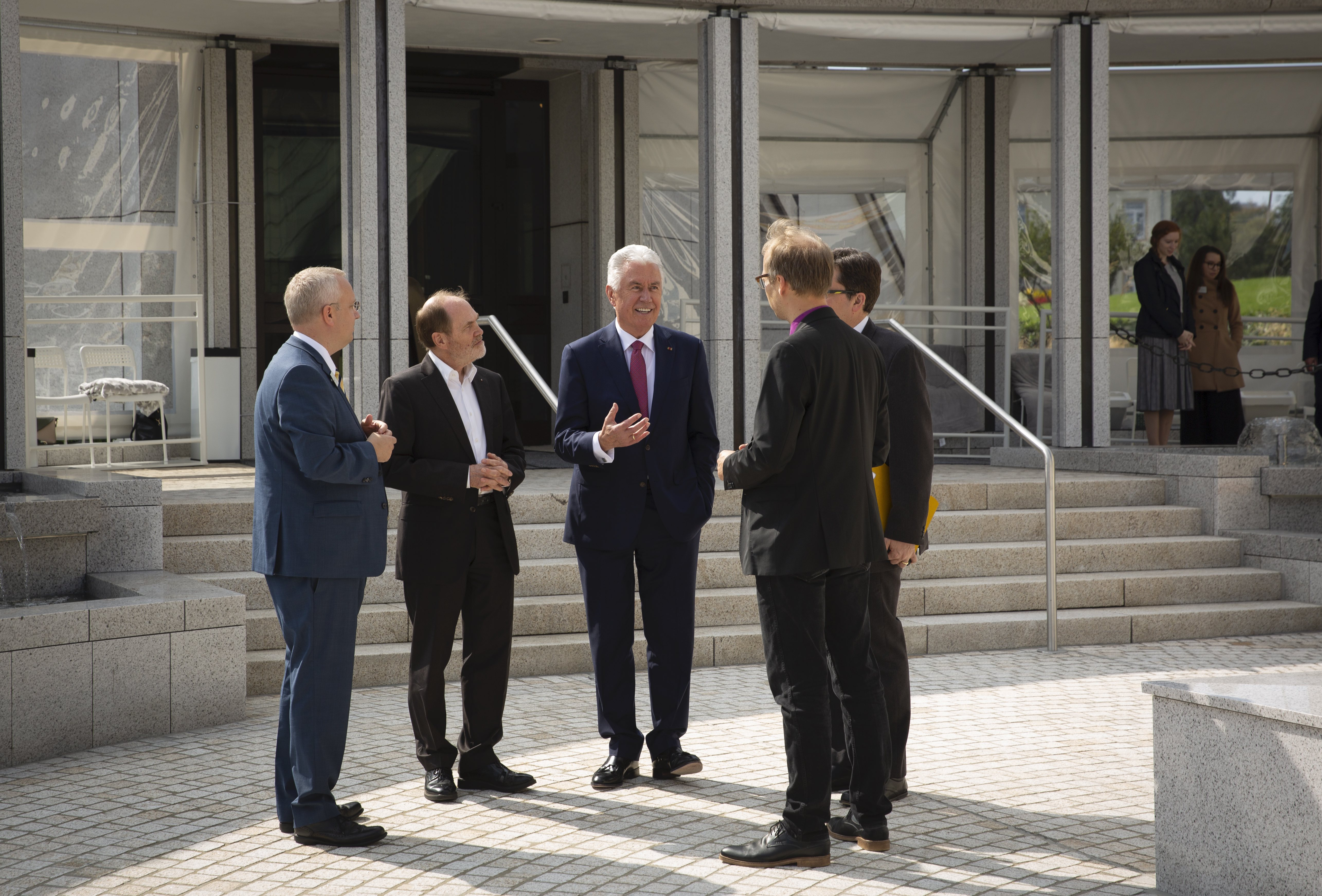 Elder Dieter F. Uchtdorf speaks with journalists outside the Frankfurt Temple in Friedrichsdorf, Germany, on Tuesday, Sept. 10, 2019.