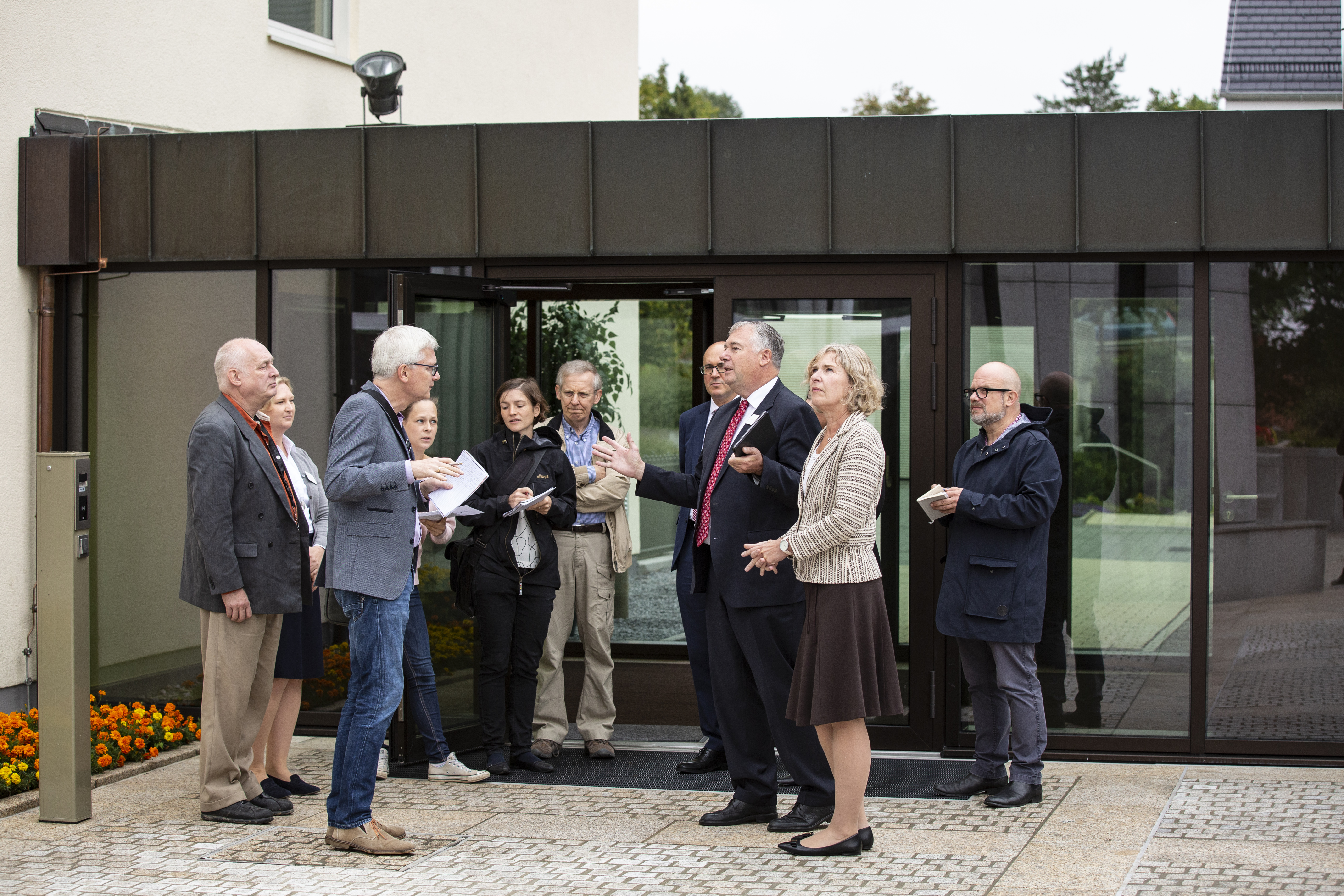 Elder Erich W. Kopischke, center, speaks to German reporters on the patio between the Friedrichsdorf stake center and the Frankfurt Temple on Monday, Sept. 9, 2019. Elder Kopischke, a General Authority Seventy and counselor in the Europe Area Presidency, gave the reporters a tour of the renovated temple after a press briefing about the open house, which begins Friday and runs through Sept. 28.