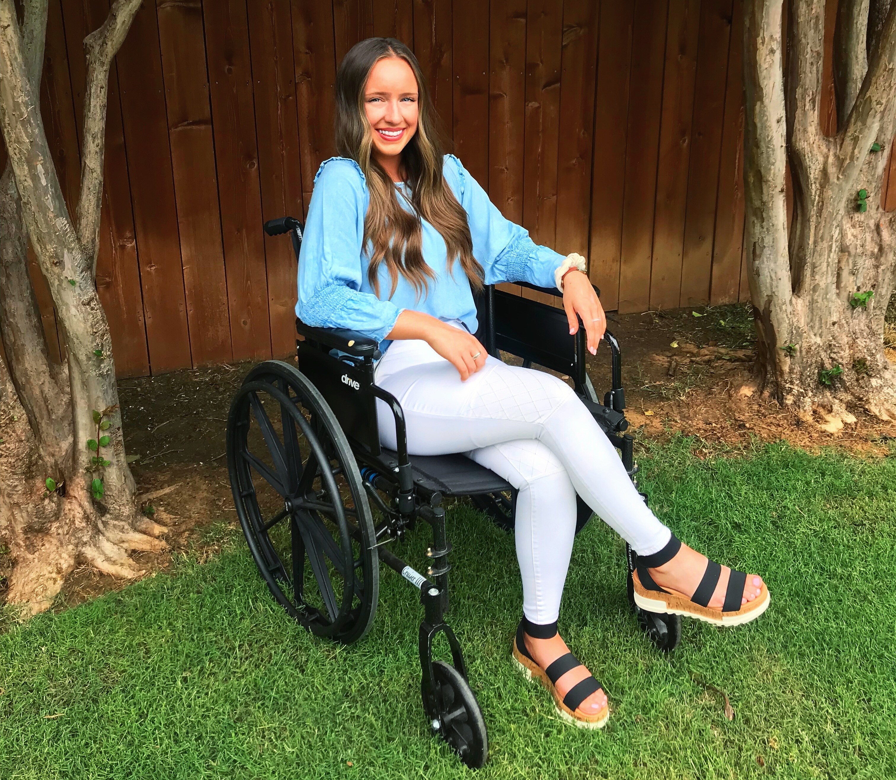 Monique McDown in a wheelchair following an accident which left her right leg paralyzed while she was serving a full time mission in Brazil.