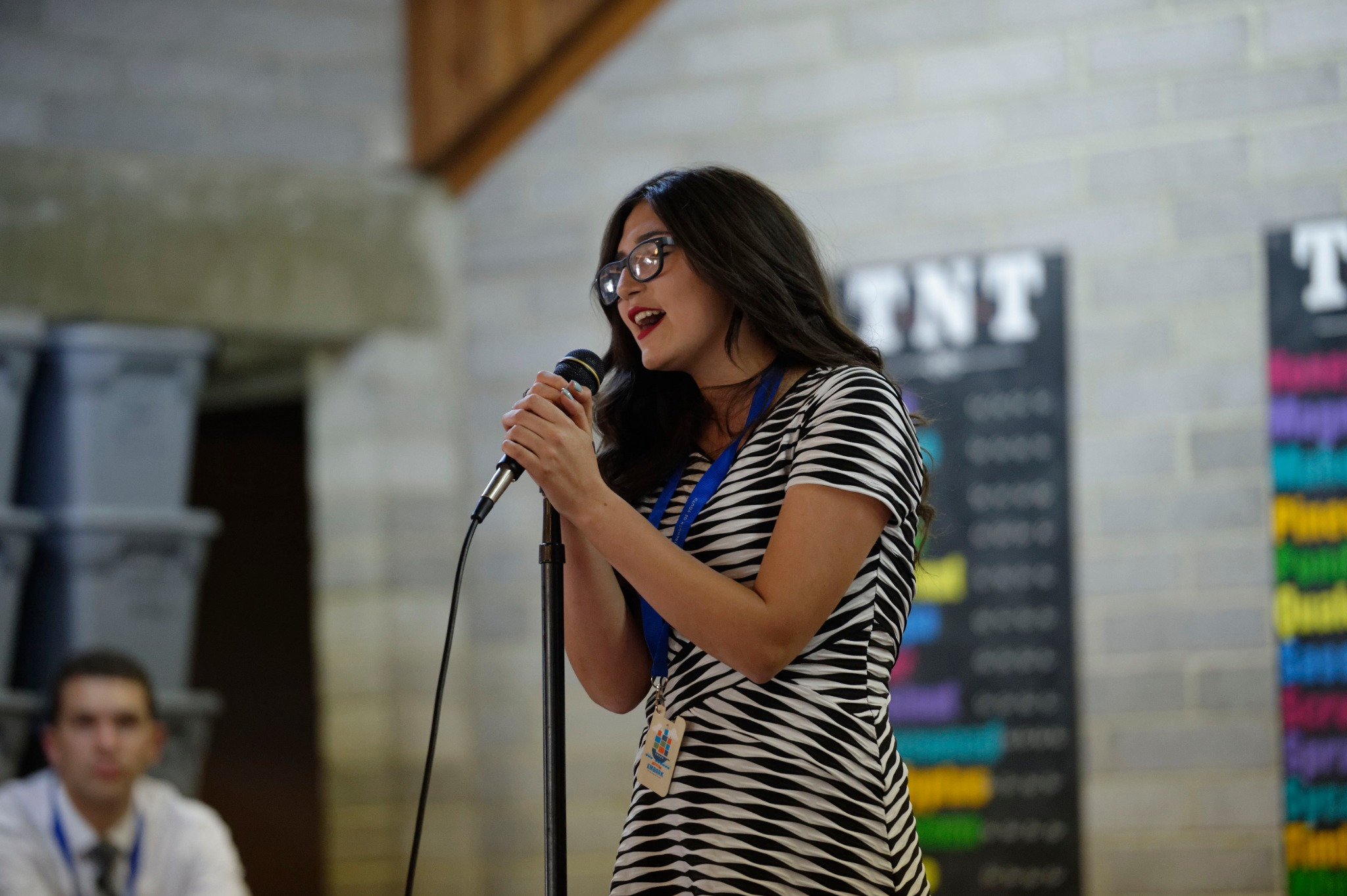 A Latter-day Saint young woman sings during a For the Strength of Youth Conference.