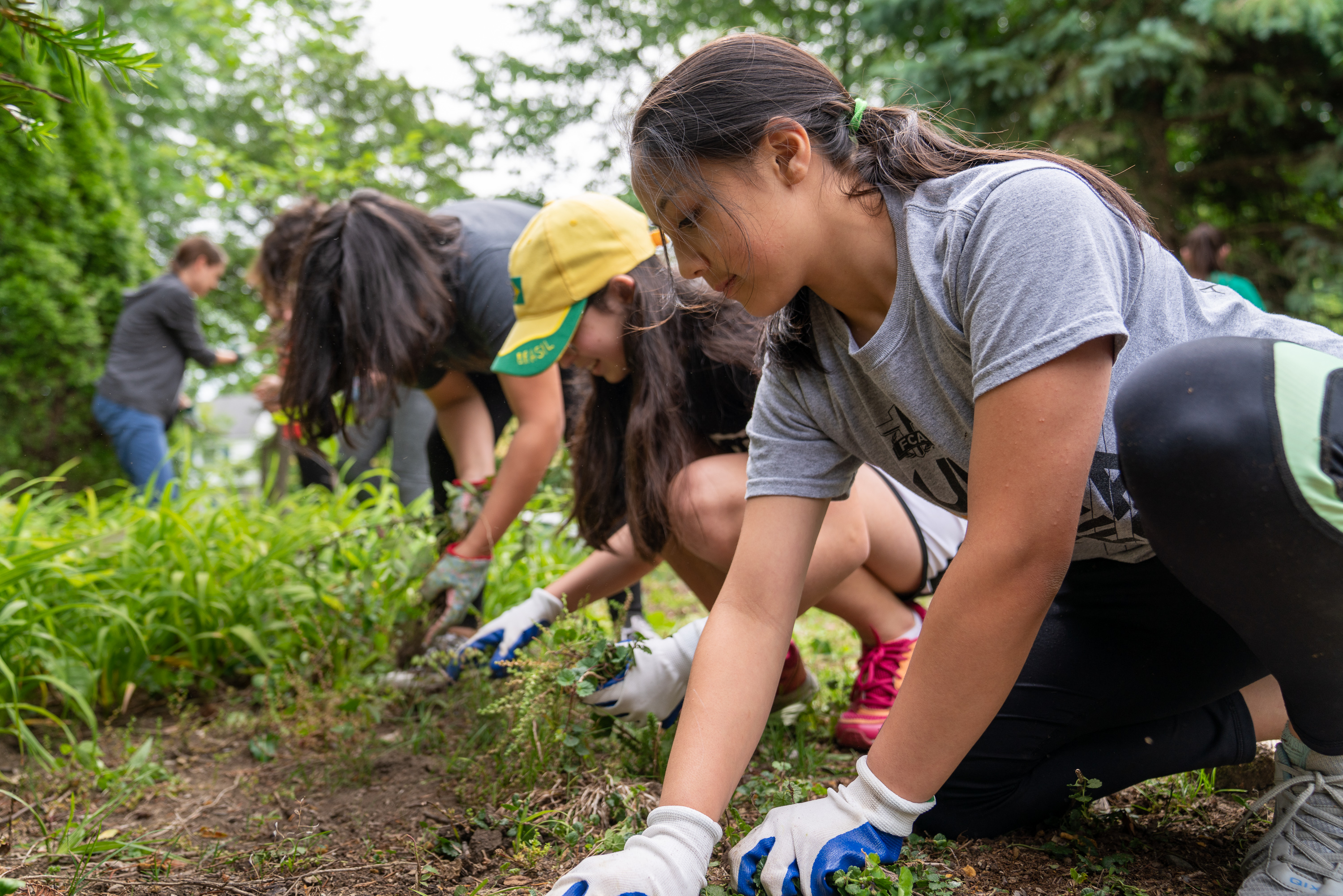 Young women participate in a service project in Columbus, Ohio. Service and activities is a key component of the new Children and Youth program.