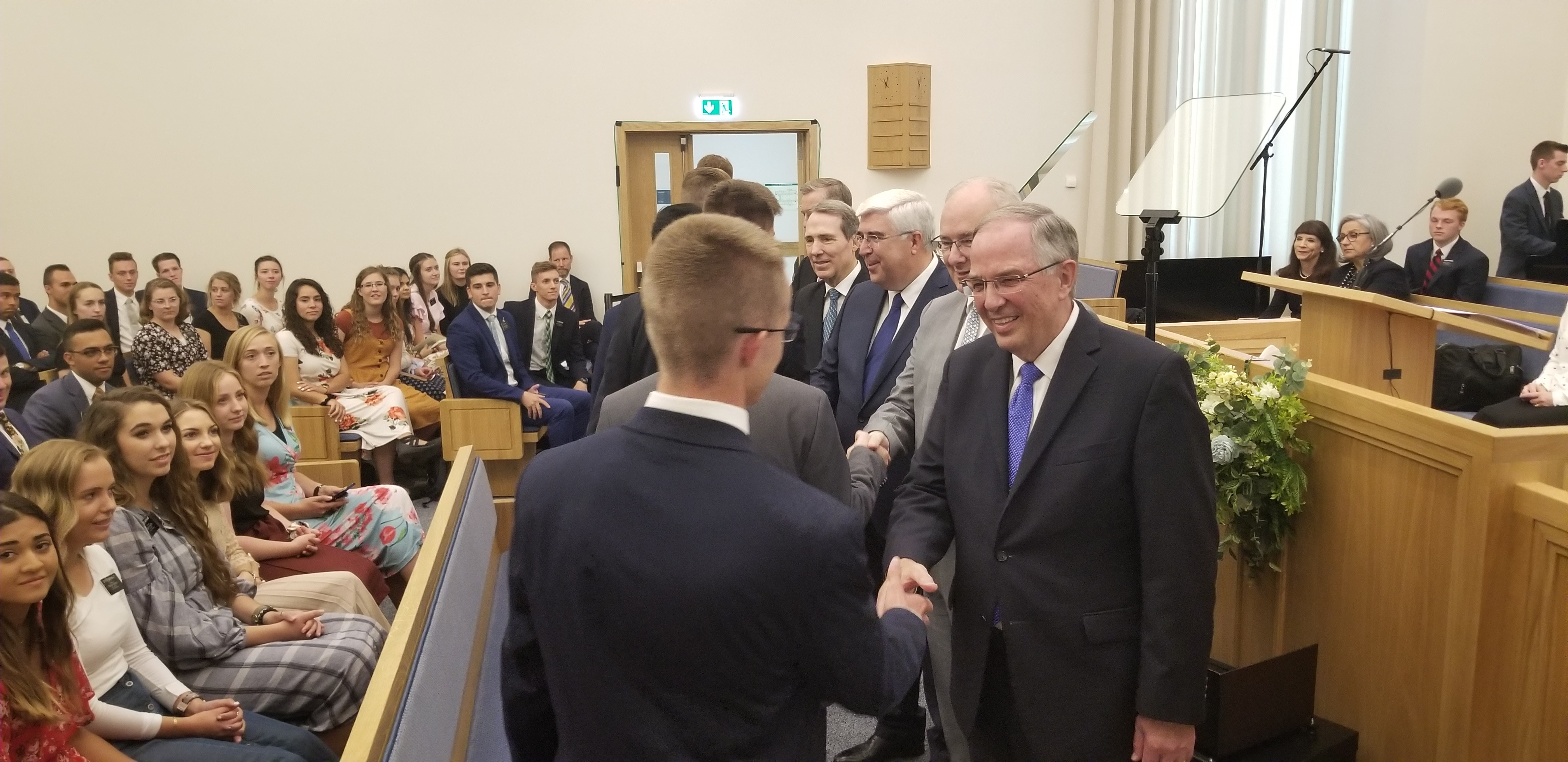 Elder Neil L. Andersen of the Quorum of the Twelve, right, greets Portugal Lisbon Mission missionaries with President Brent Fillmore of the mission, Elder José A. Teixeira, Elder Gary B. Sabin and Elder Kevin R. Duncan prior to a missionary meeting Saturday, Sept. 14, 2019, in Lisbon.