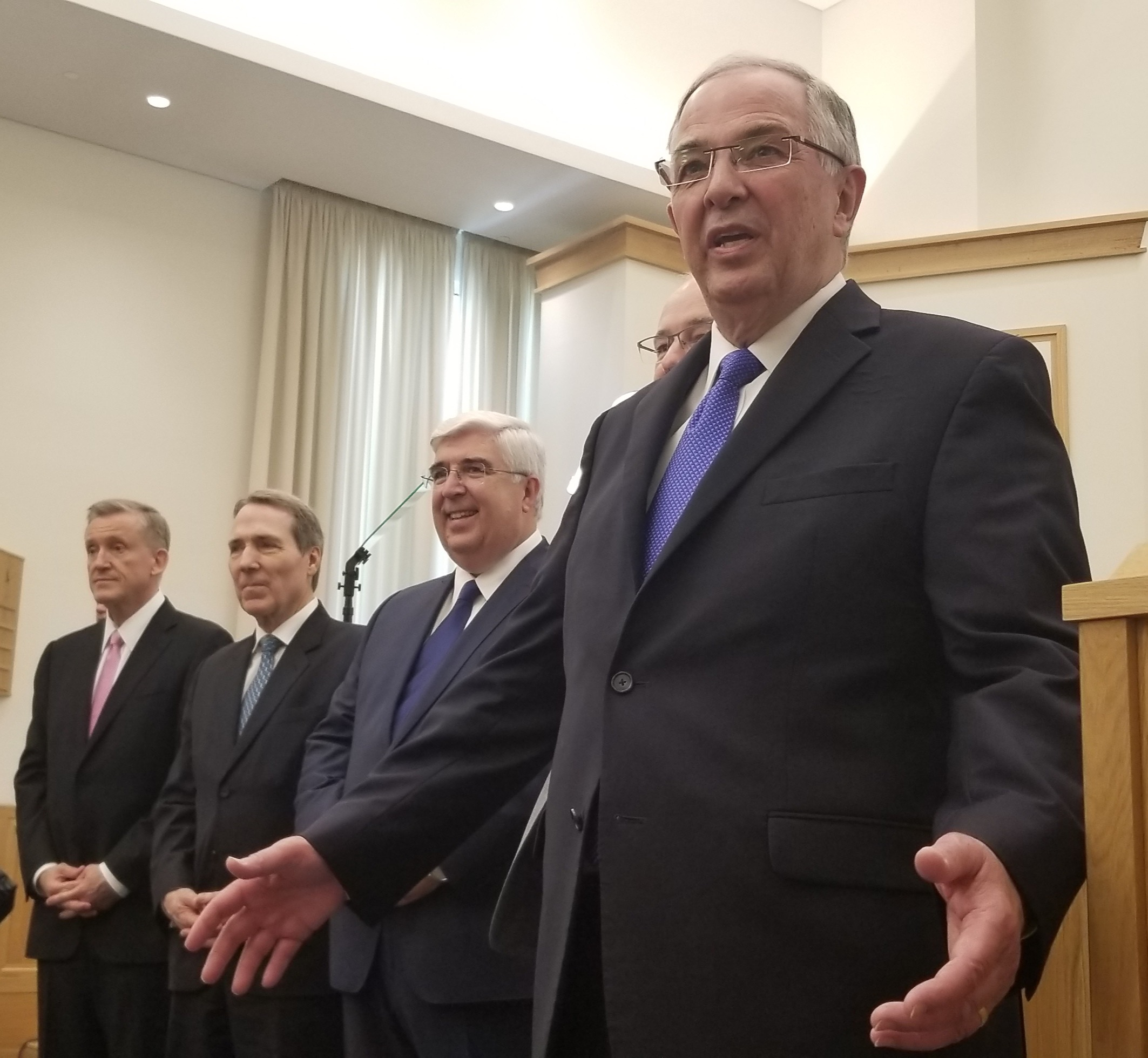 Elder Neil L. Andersen of the Quorum of the Twelve, right, gestures while speaking addressing missionaries of the Portugal Lisbon Mission prior to a Saturday, Sept. 14, 2019, meeting in Lisbon. He's joined by President Brent Fillmore of the mission, Elder José A. Teixeira, Elder Gary B. Sabin and Elder Kevin R. Duncan.