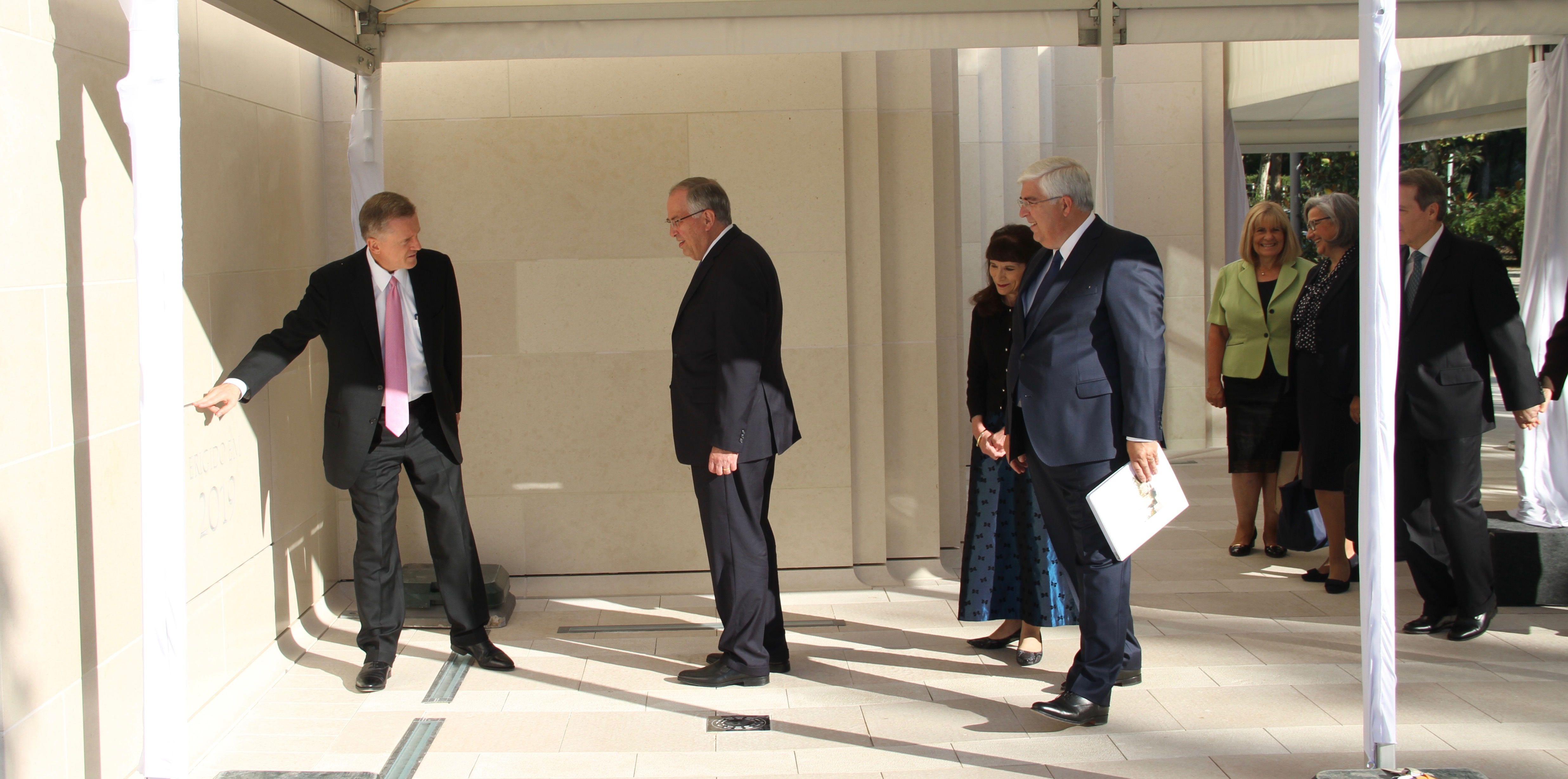 Elder Kevin R. Duncan, left, a General Authority Seventy and executive director of the Temple Department, talks to Elder Neil L. Andersen of the Quorum of the Twelve Apostles about the setup for the upcoming cornerstone ceremony at the Lisbon Portugal Temple following their walk-through of the facility on Saturday, Sept. 14, 2019. Behind them are Sister Kathy Andersen and Elder José A. Teixeira of the Presidency of the Seventy.