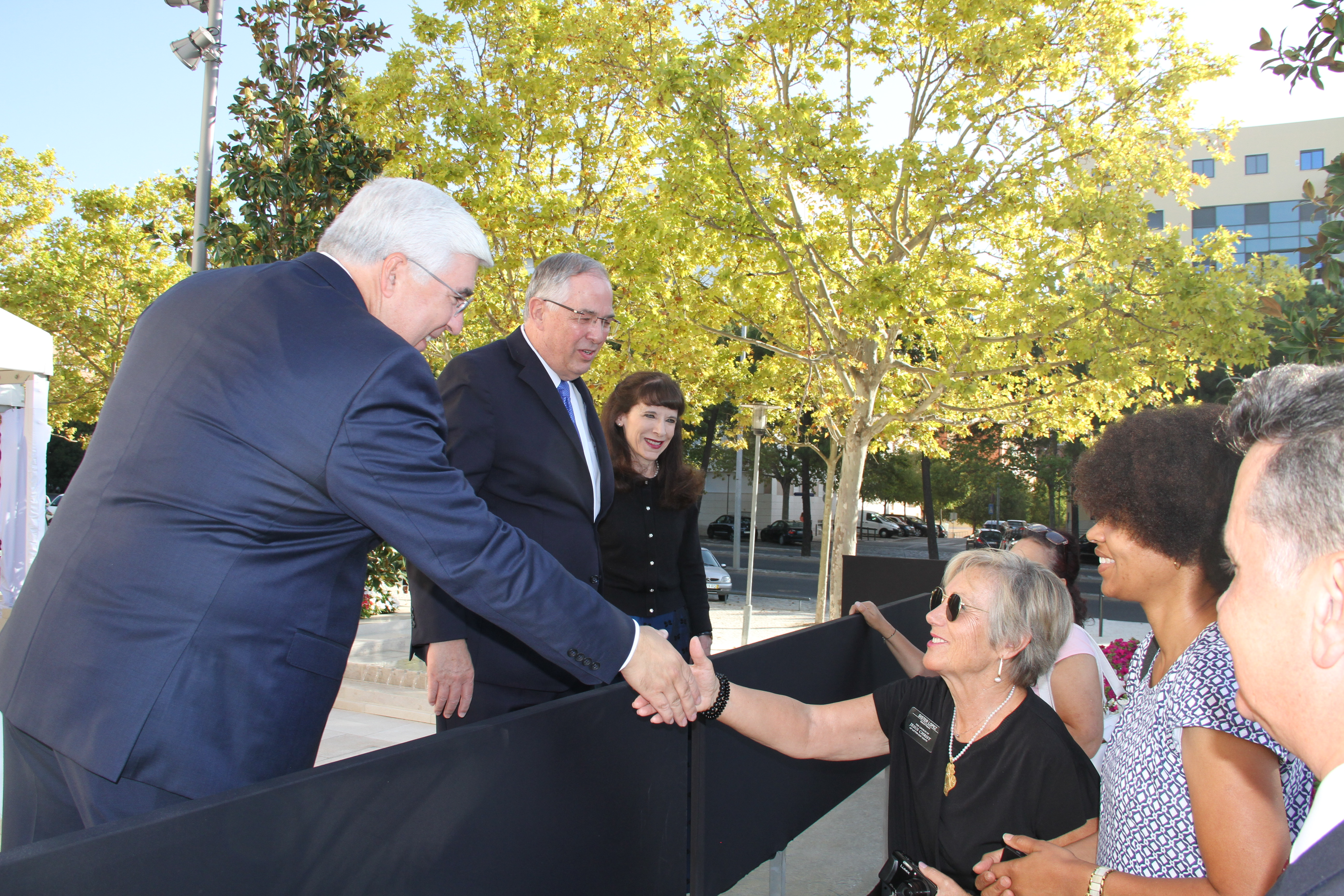 Elder José Teixeira of the Presidency of the Seventy and native of Portugal, greets members outside the Lisbon Portugal Temple along with Elder Neil L. Andersen of the Quorum of the Twelve Apostles and his wife, Sister Kathy Andersen, following a walk-through of the tempe on Saturday, Sept. 14, 2019.