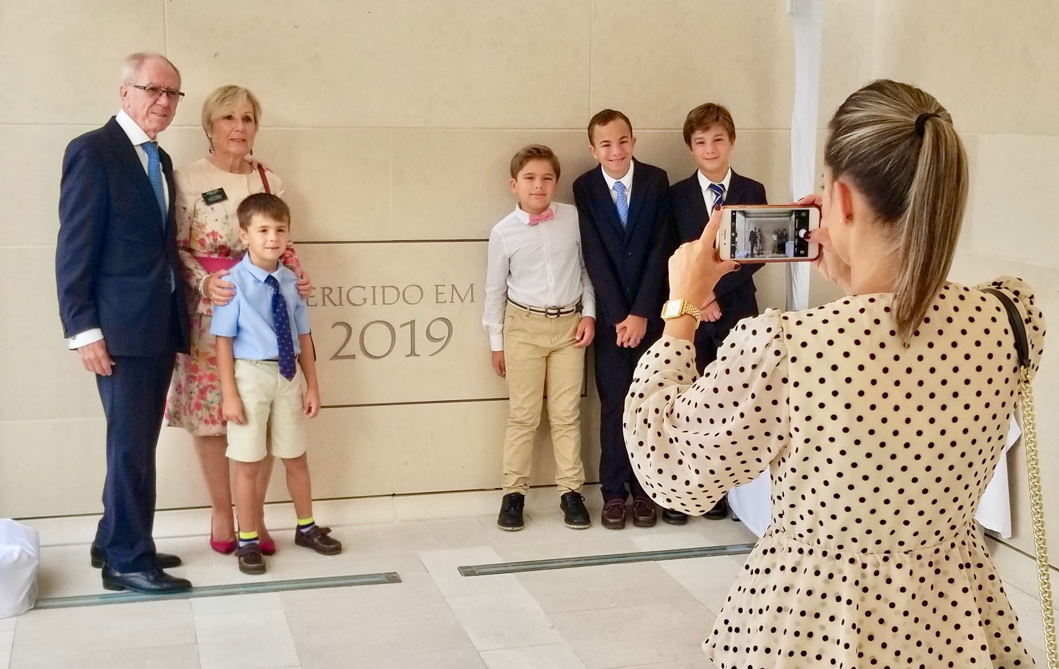 Local Latter-day Saints gather for a photo around the cornerstone of the Lisbon Portugal Temple on the day of its dedication, Sunday, Sept. 15, 2019.
