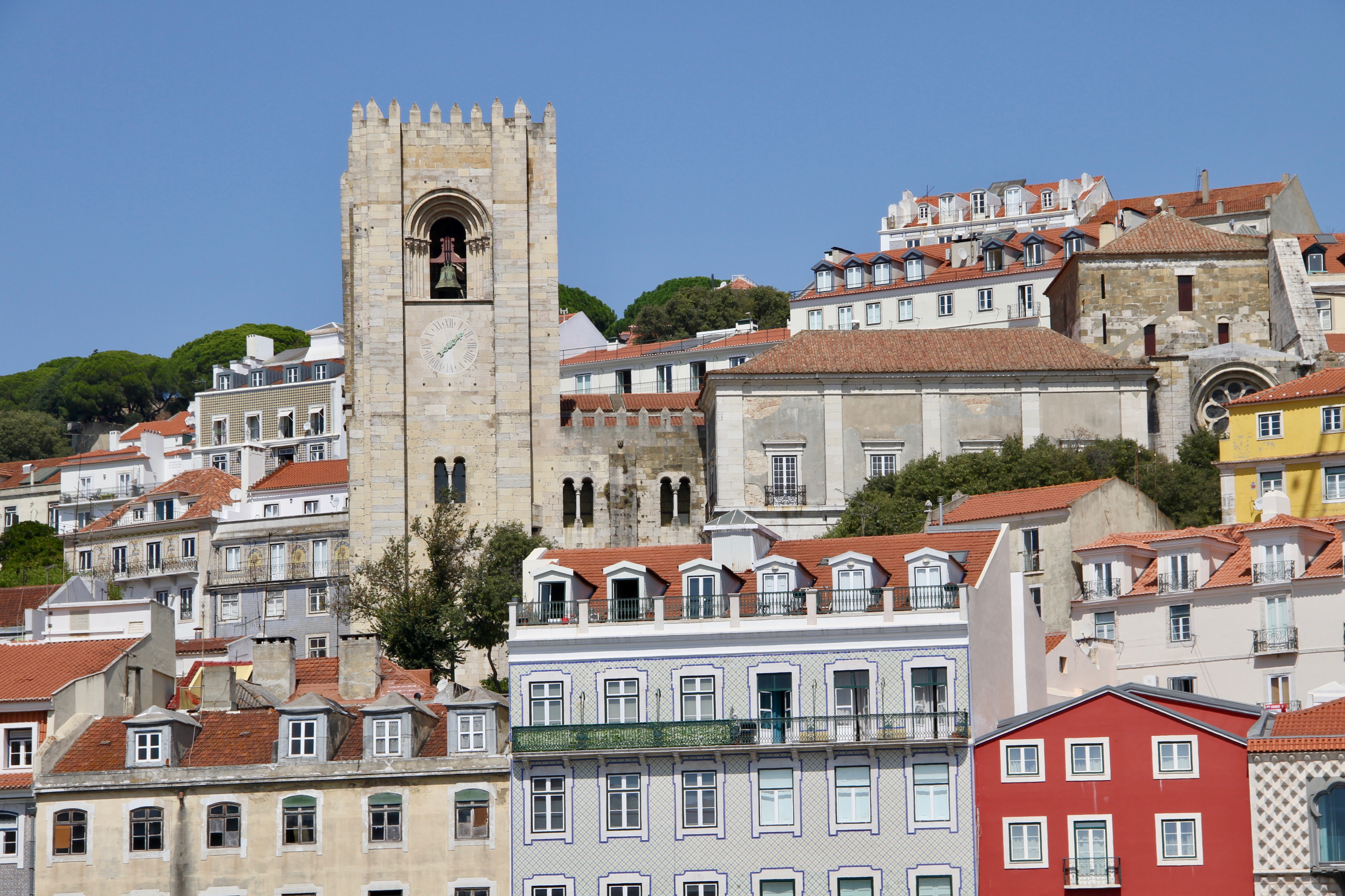 A view of central Lisbon, Portugal, includes residential buildings and a side view of the Lisbon Cathedral on Sunday, Sept. 15, 2019.
