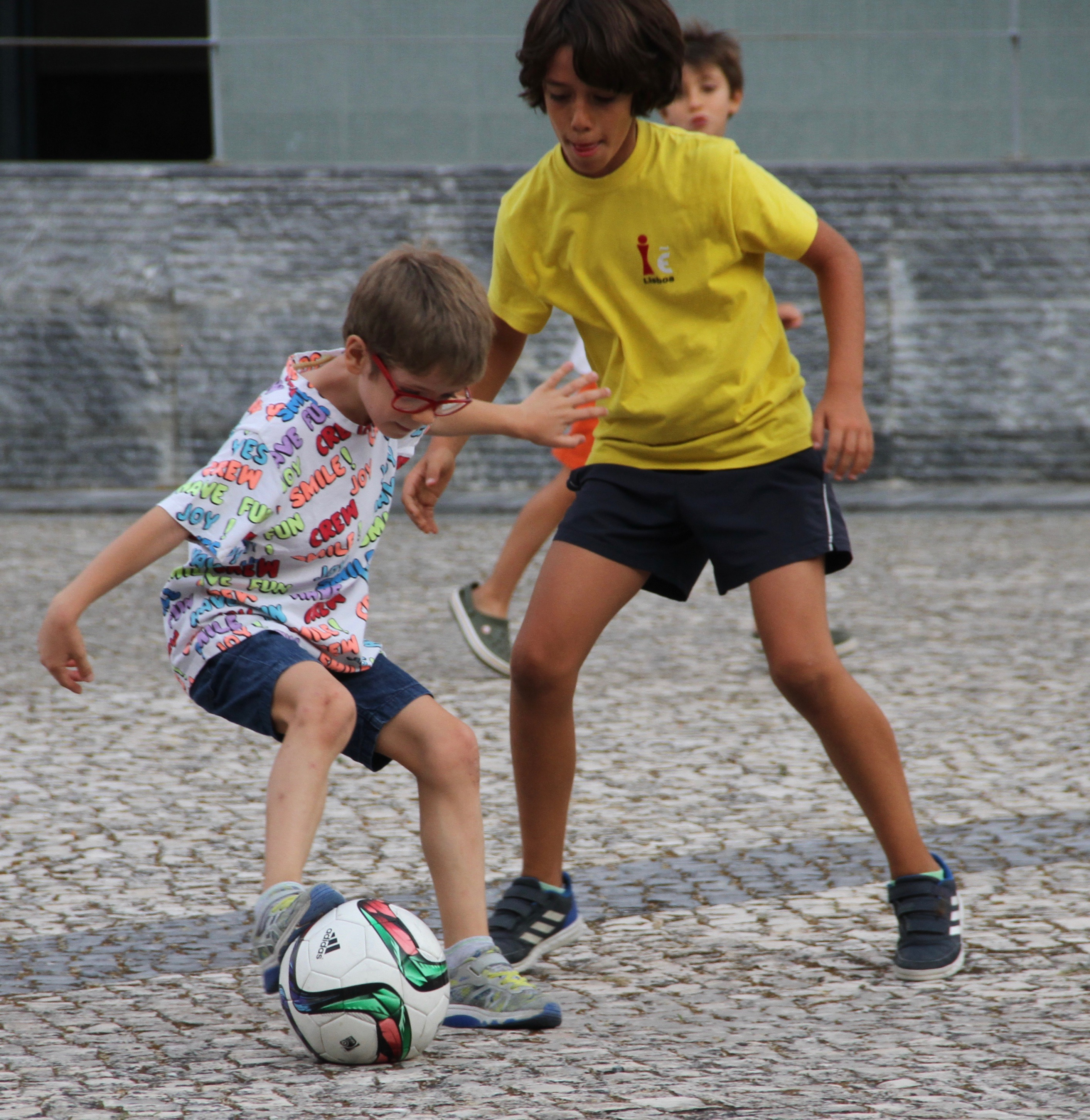 Young boys play soccer in a plaza in Lisbon, Portugal, on Saturday, Sept. 14, 2019.