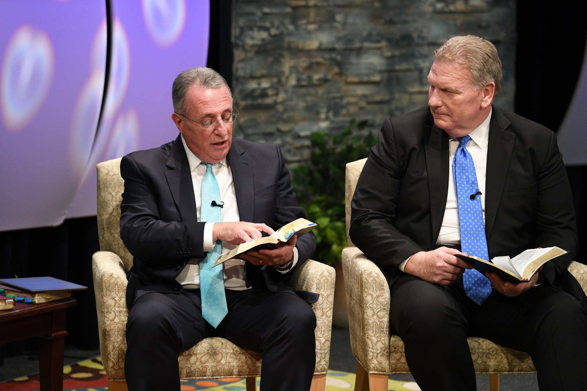 Elder Ulisses Soares (left) of the Quorum of the Twelve Apostles and Elder Craig C. Christensen of the Seventy participate in a live 90-minute Worldwide Devotional Face to Face broadcast for young adults of The Church of Jesus Christ of Latter-day Saints on September 15, 2019.