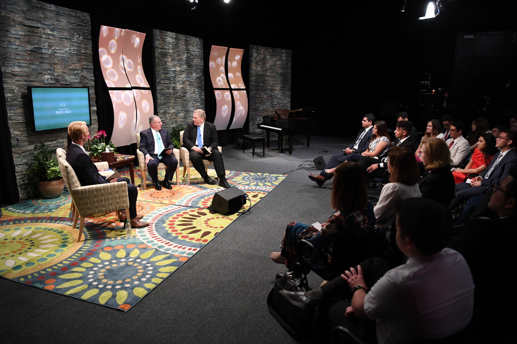 A Brigham Young University studio is the location of a Worldwide Devotional Face to Face broadcast with young adults on Sunday, September 15, 2019. Elder Ulisses Soares of the Quorum of the Twelve Apostles and Elder Craig C. Christensen of the Seventy participate in live 90-minute program.