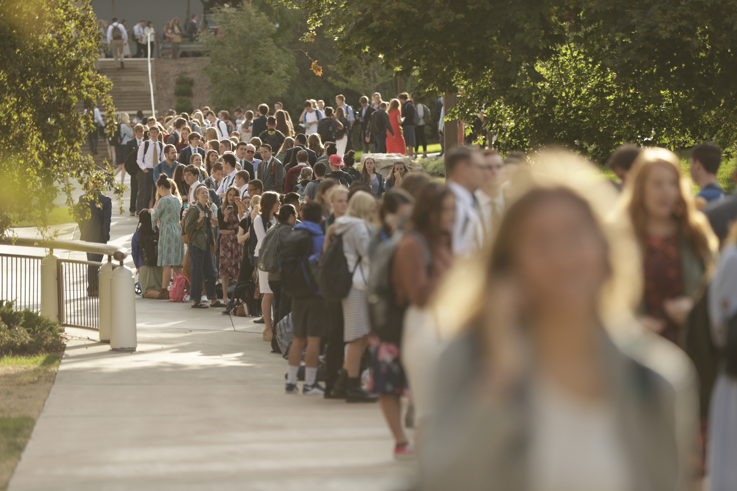 Students line up to enter the Marriott Center on BYU campus in preparation for a devotional by President Russell M. Nelson on Tuesday, Sept. 17, 2019.