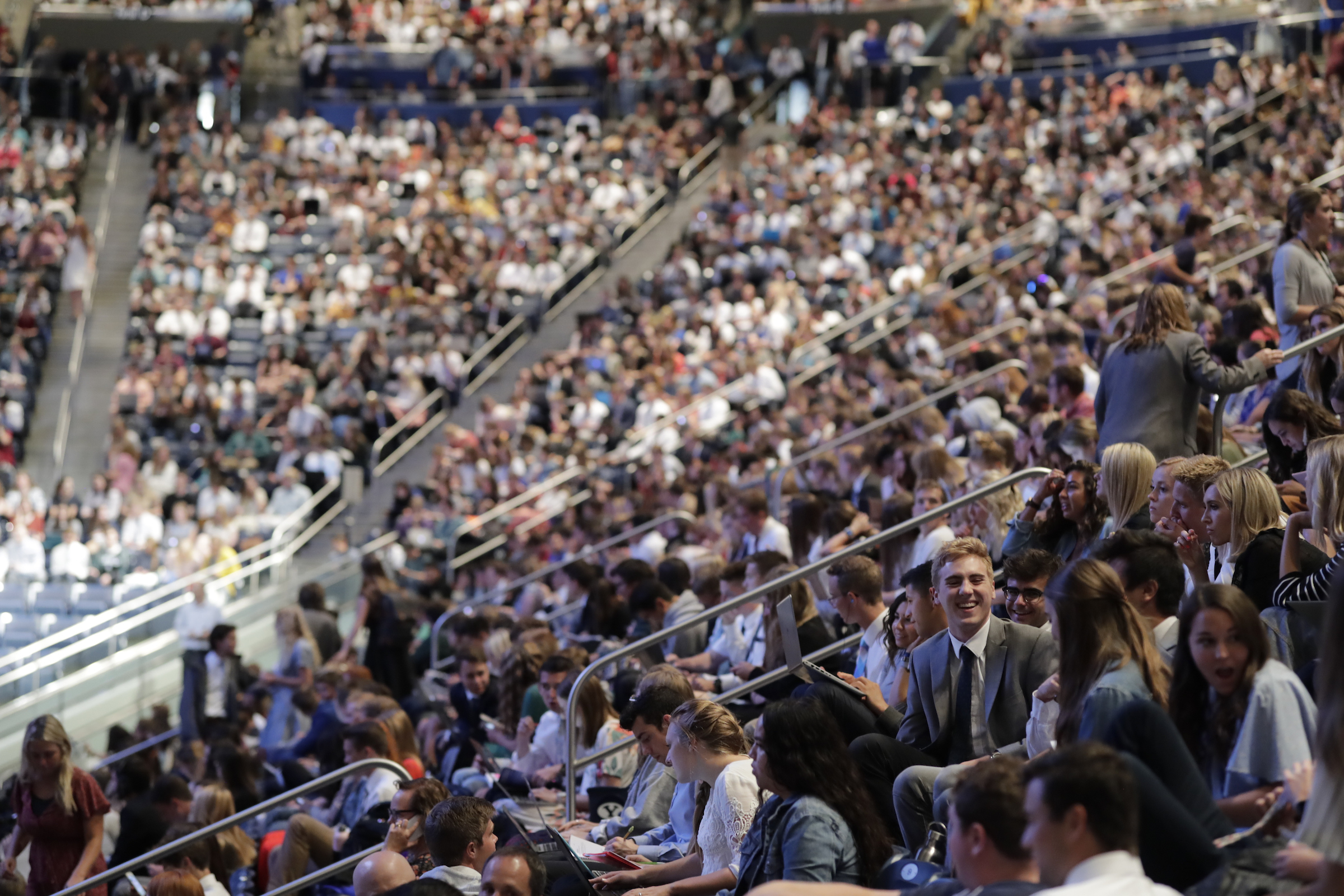 Students take their seats in the Marriott Center on BYU campus in preparation for a devotional by President Russell M. Nelson on Tuesday, Sept. 17, 2019.