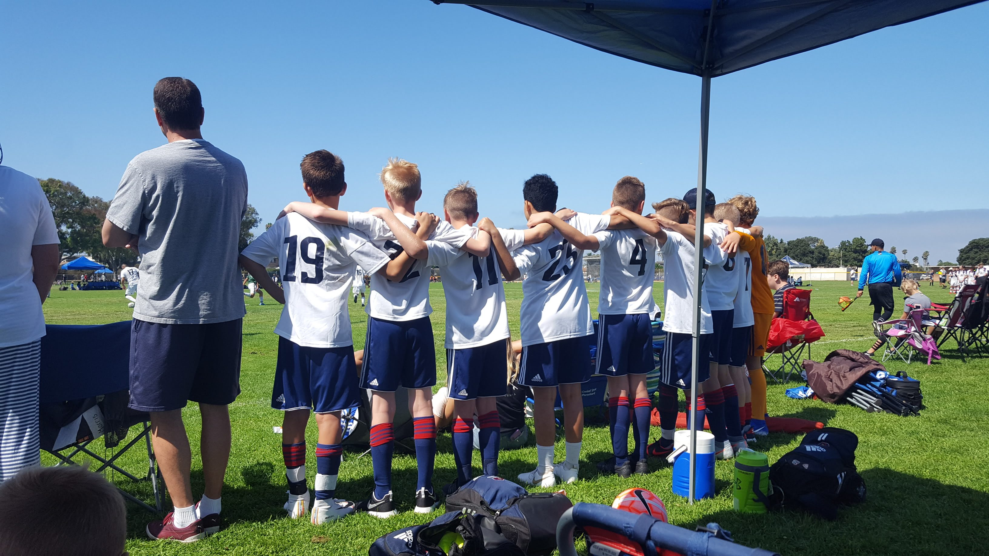 The 2007 Boys Blue soccer team stands with their arms around each other during a tournament in La Jolla in San Diego, California in September 2019.