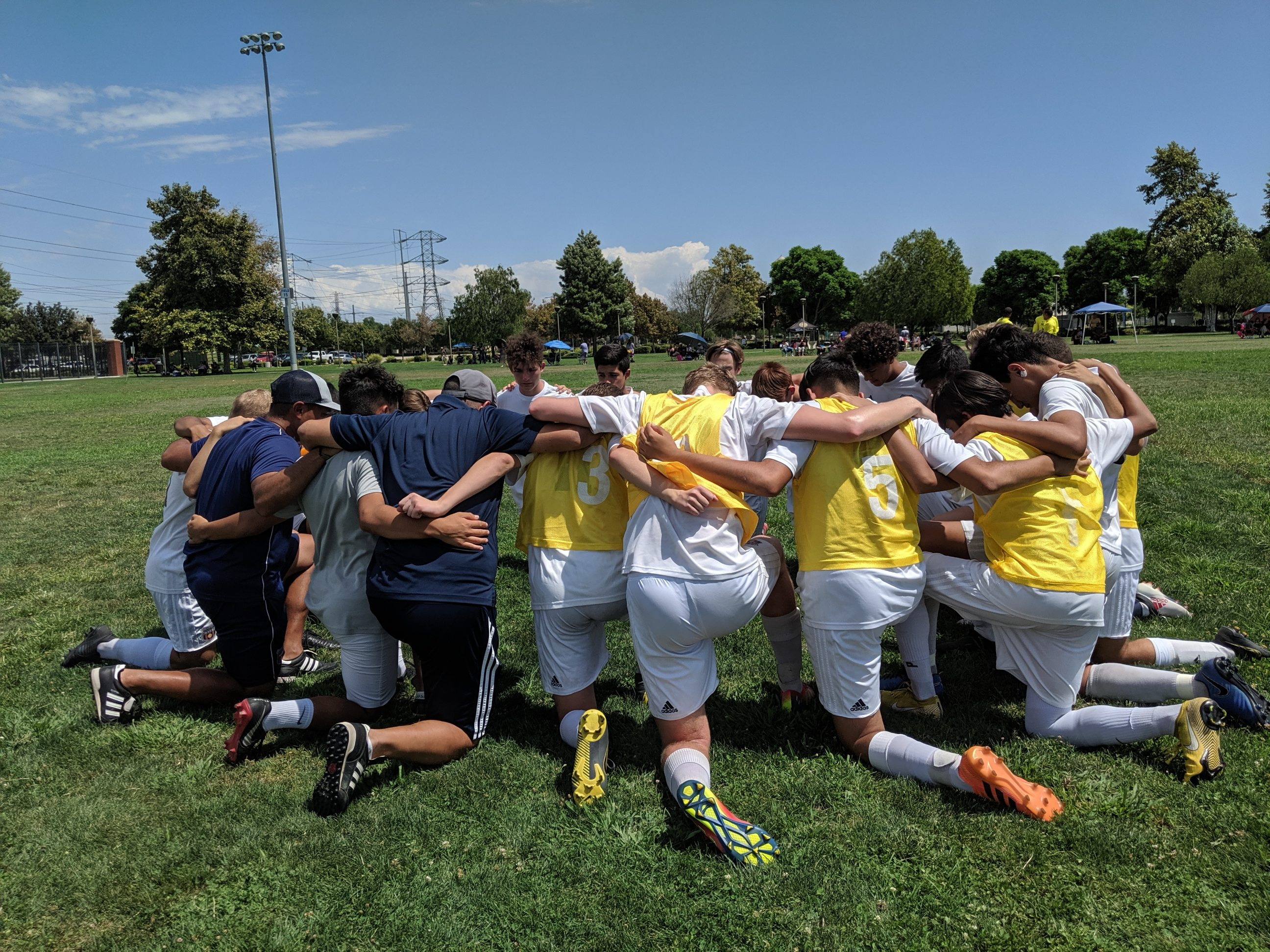 The 2003 Boys Blue team prays before the championship game of the Labor Day Classic tournament in Chino Hills, California on Sept. 2, 2019.