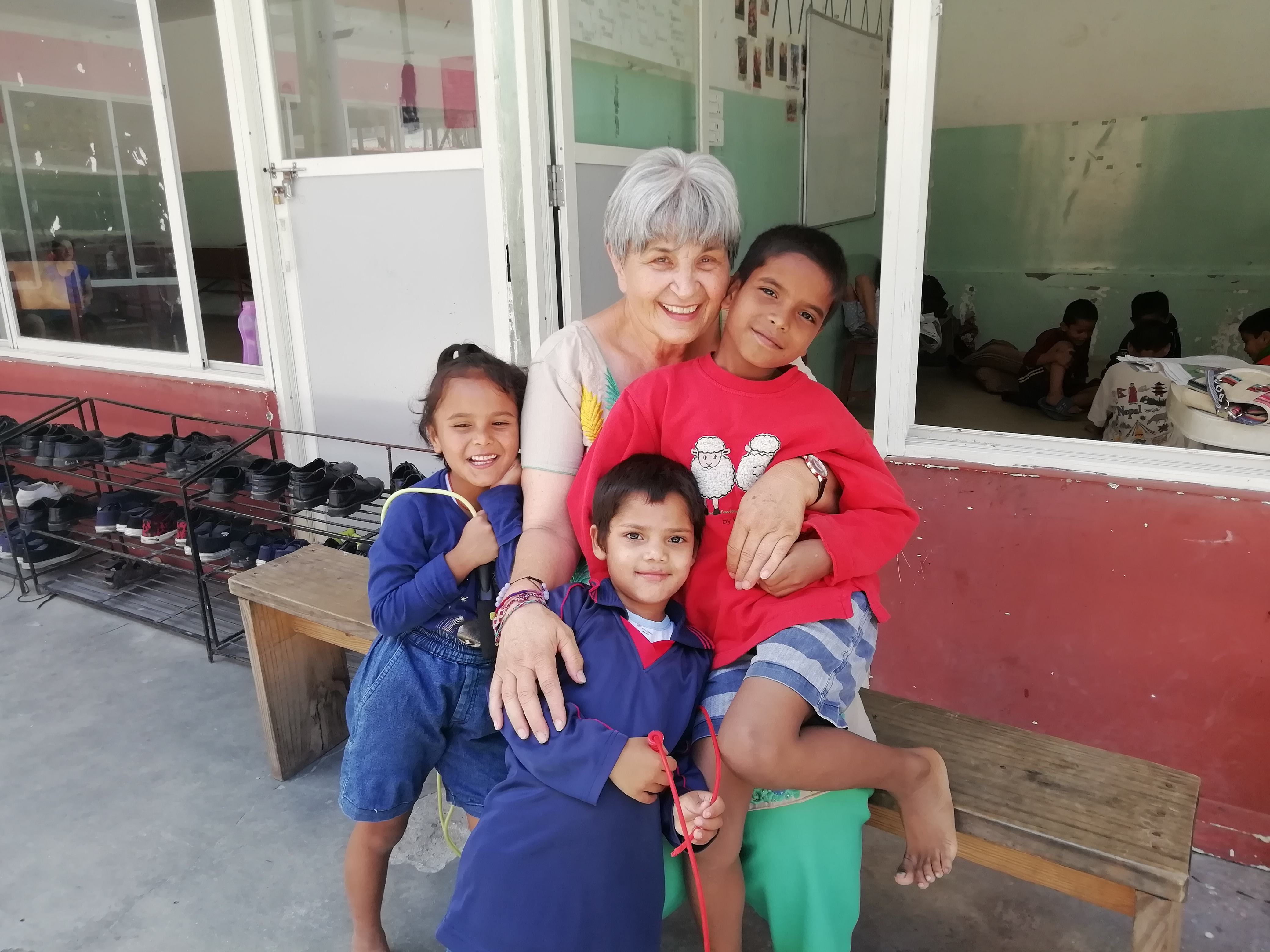 "Children from Home of Hope in Nepal spend time with their ""Aunt"" Ellen during one of her visits in the home's courtyard in 2019. Ellen Dietrich is the founder and chairwoman of Home of Hope or Self Help Nepal as it is also known."