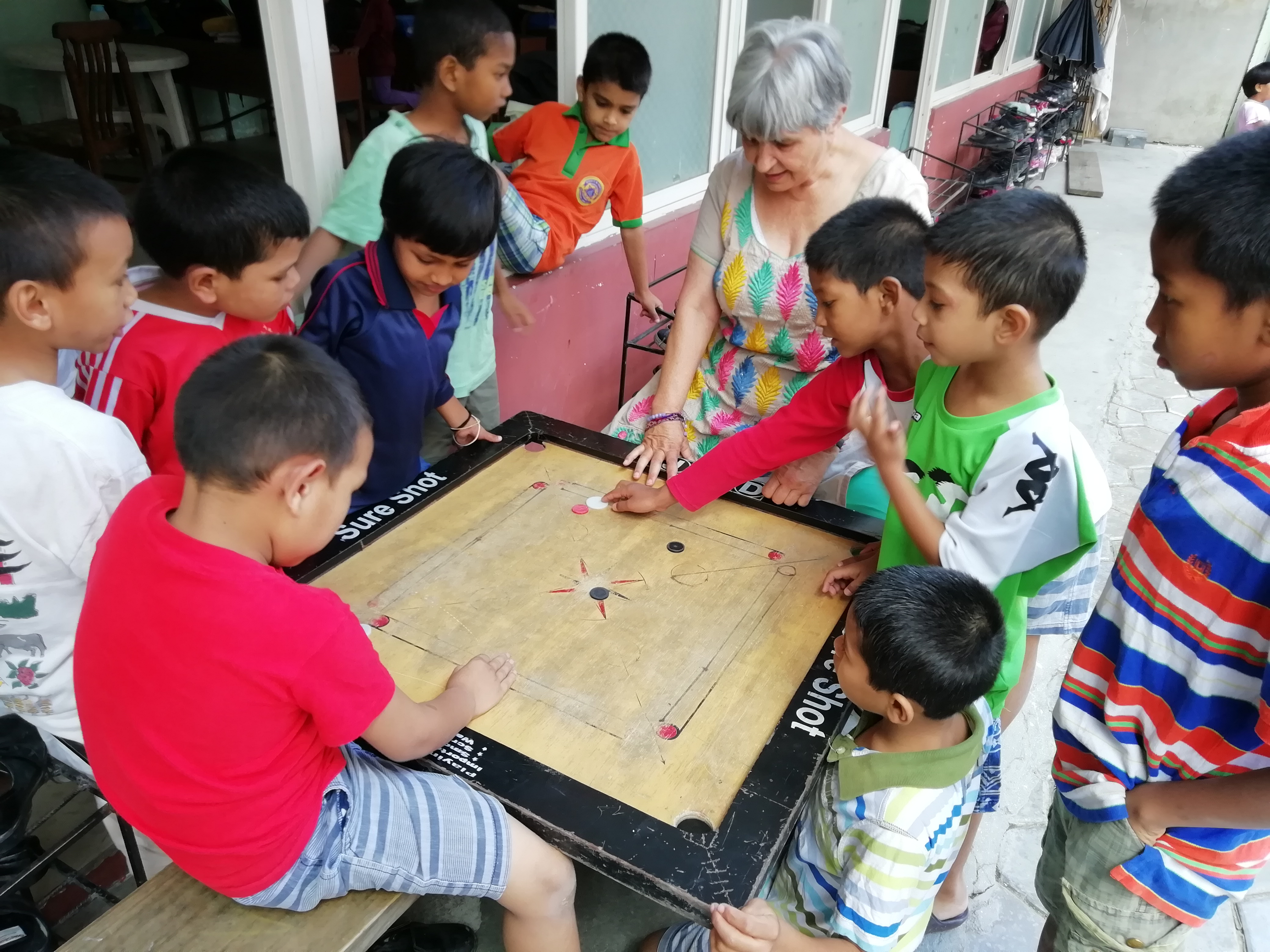 "Home of Hope children in Kathmandu, Nepal play a game with their ""Aunt"" Ellen in the home's courtyard during one of her visits in 2019. Ellen Dietrich is the founder and chairwoman of Home of Hope or Self Help Nepal as it is also known."