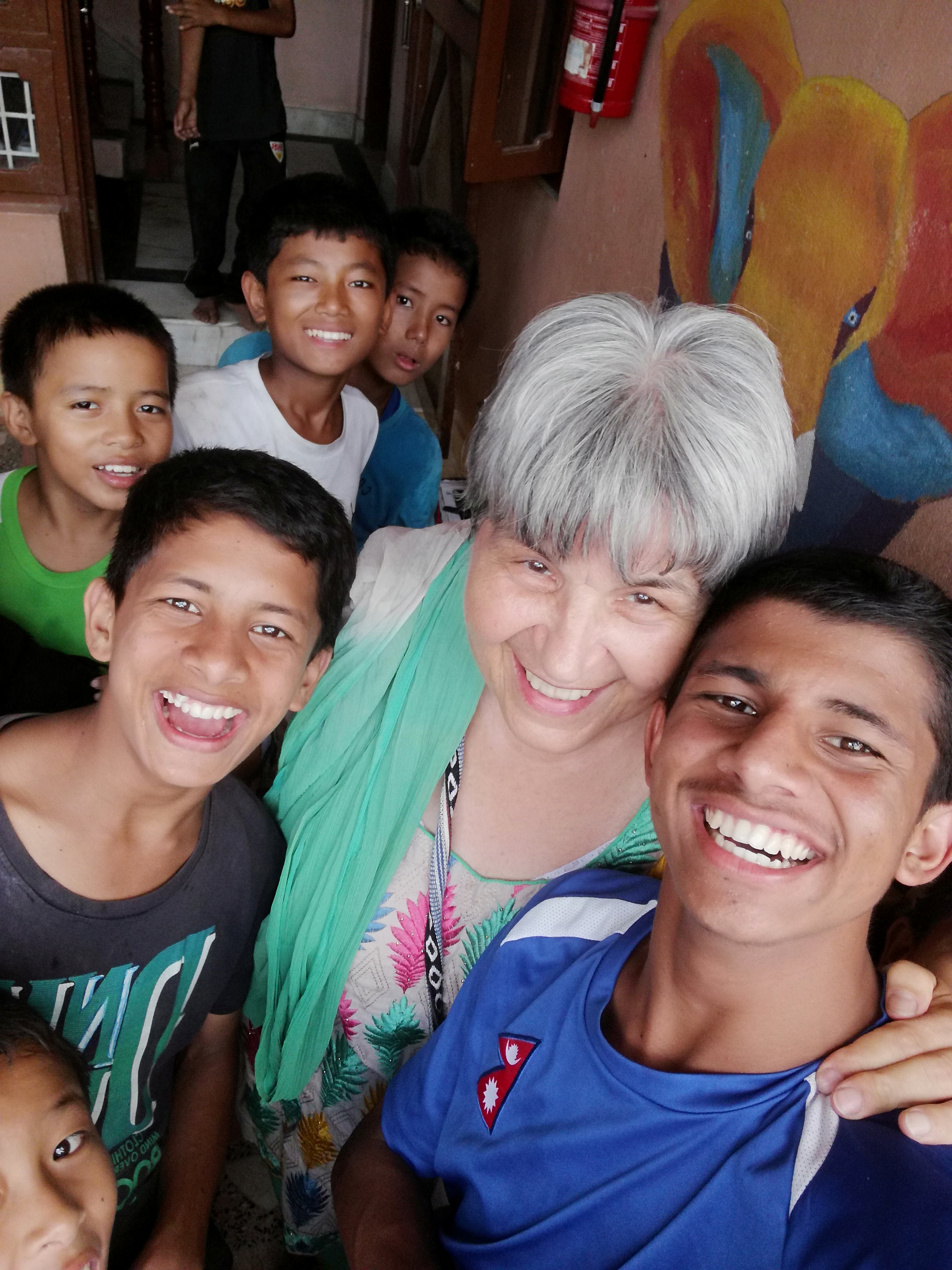 Ellen Dietrich takes a selfie with some of the children at her Home of Hope organization in Kathmandu, Nepal in 2019.
