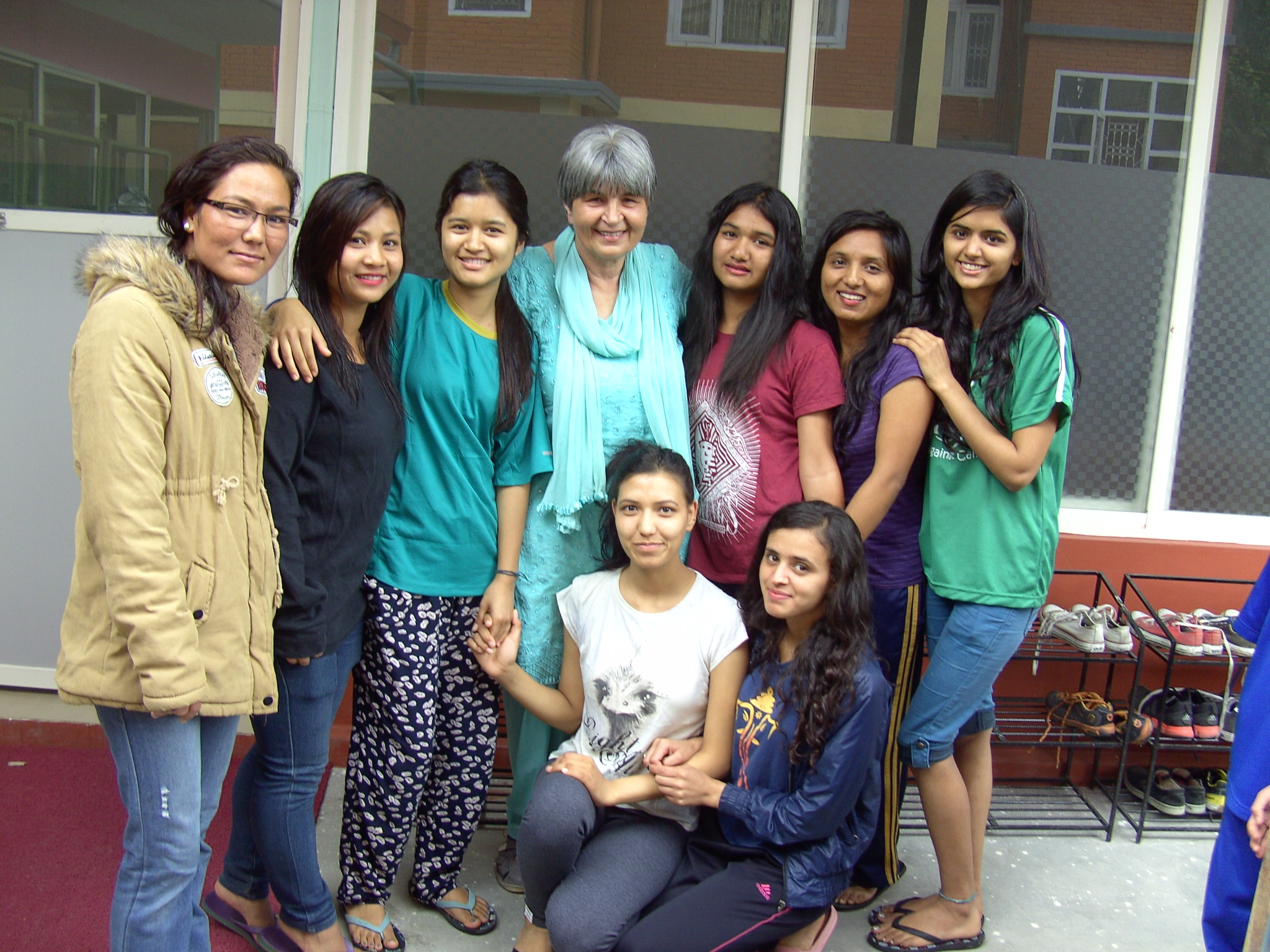 Ellen Dietrich poses with some of the girls who live in the Home of Hope in Kathmandu, Nepal in 2016. Home of Hope is a charity organization Ellen Dietrich founded in 1998.